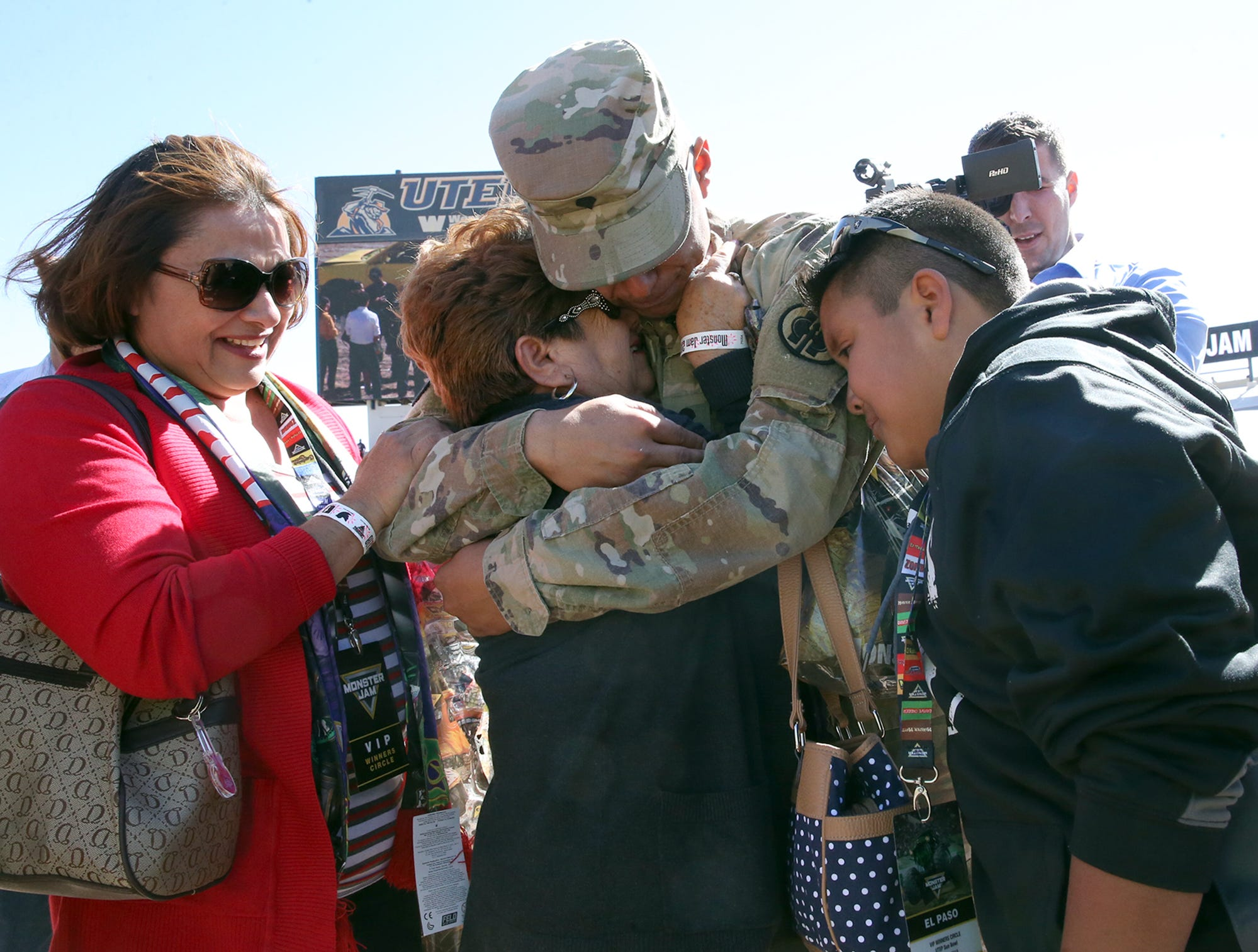 Spc. Pedro Ceijas, center, is greeted by mother, Morma Ceijas, left, aunt Vicky Beltran, center, and brother Trigo Ceijas, 11, with other relatives on the floor of the Sun Bowl Stadium at the start of Monster Jam event Sunday. Ceijas, 20, of the 83rd Military Police Company of the Army Reserve surprised his family after being away on deployment to Kuwait and Iraq the past nine months. As Monster Jam fans, Ceijas knew the family would be there and ran out to greet them after they were introduced as VIP fans of the event. Following the reunion, the family were escorted to the stands to watch the show.