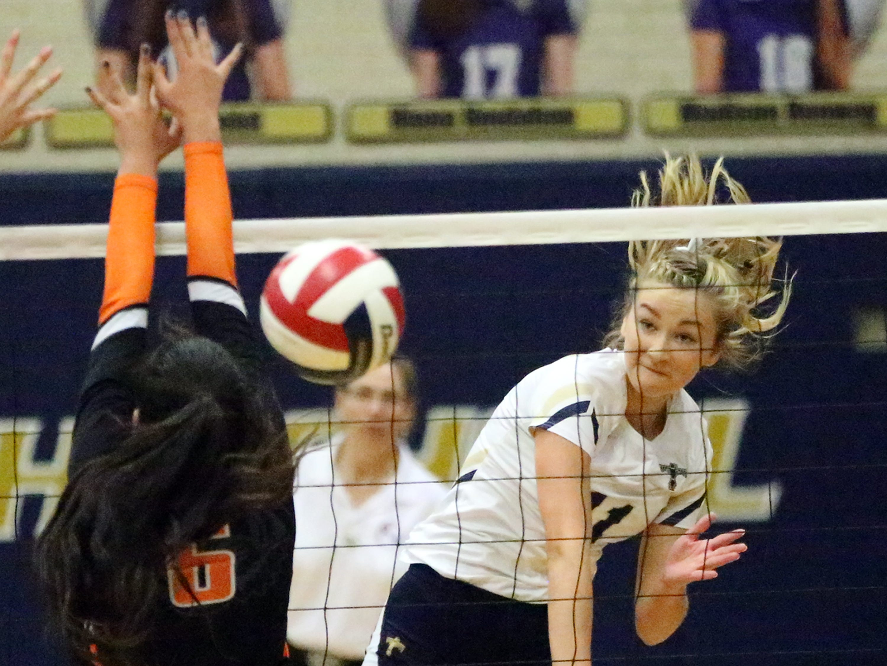 Coronado's Campbell Bowden, 11, fires a shot over the net past Hannah Payan, 6, of El Paso High Tuesday night at Coronado. The T-Birds won the contest in three sets.