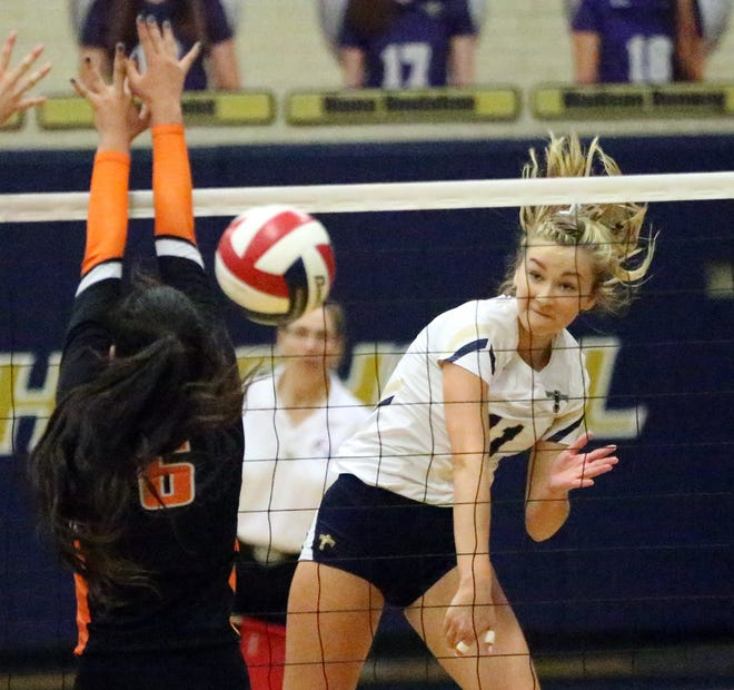 Coronado's Campbell Bowden, 11, fires a shot over the net past Hannah Payan, 6, of El Paso High at Coronado. The T-Birds won the contest in three sets.