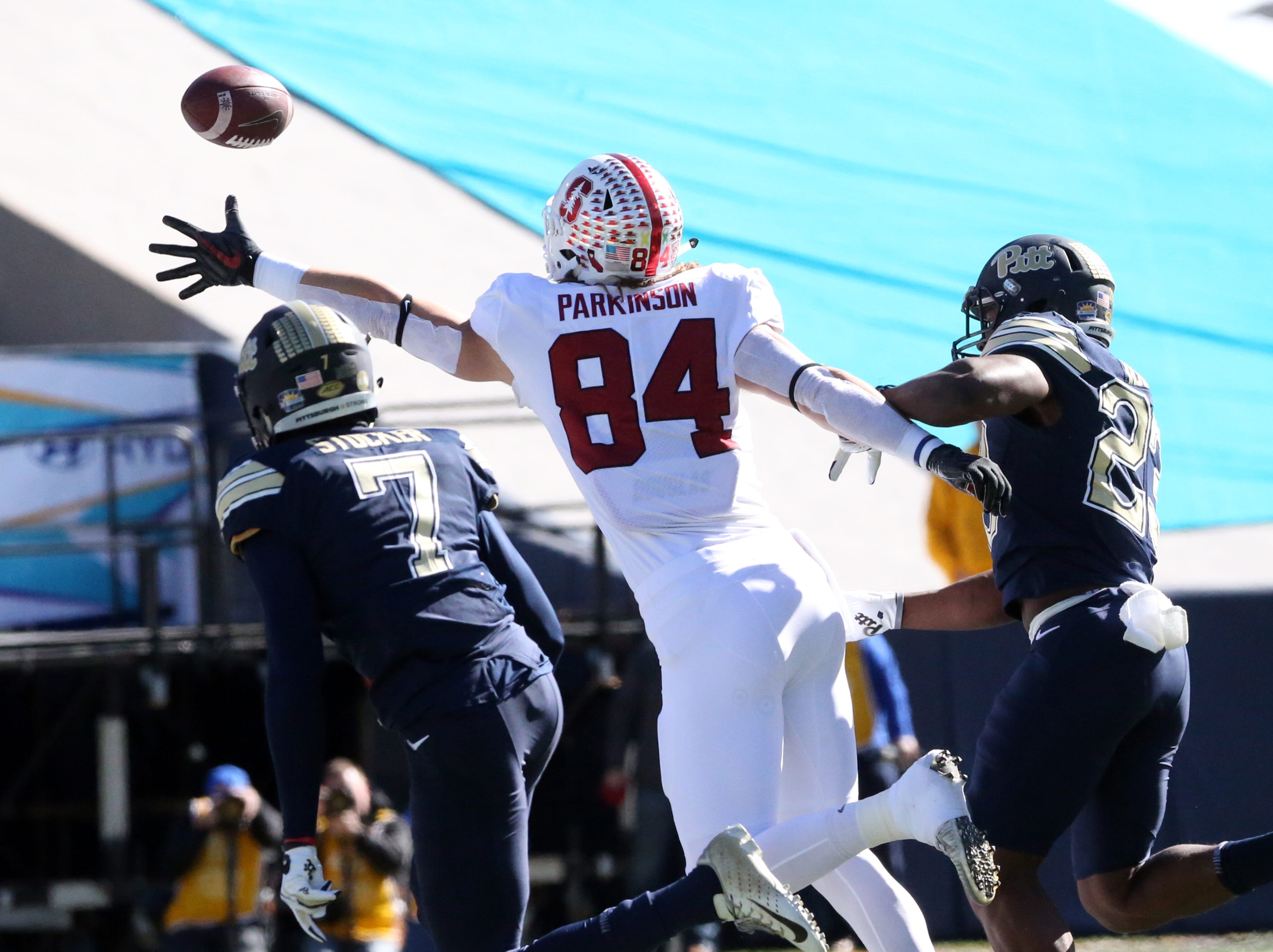 Colby Parkinson, 84, of Stanford reaches for an over thrown pass Monday.