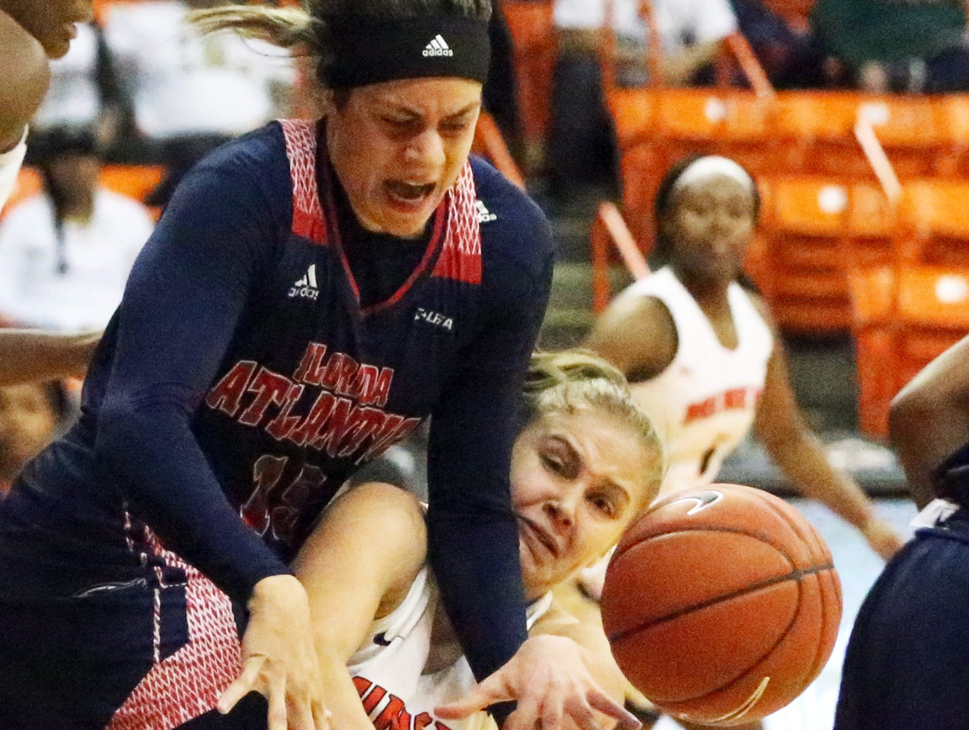 UTEP forward Zuzanna Puc, bottom, battles for a loose ball with Sasha Cedeño of Florida Atlantic Thursday night in the Don Haskins Center.