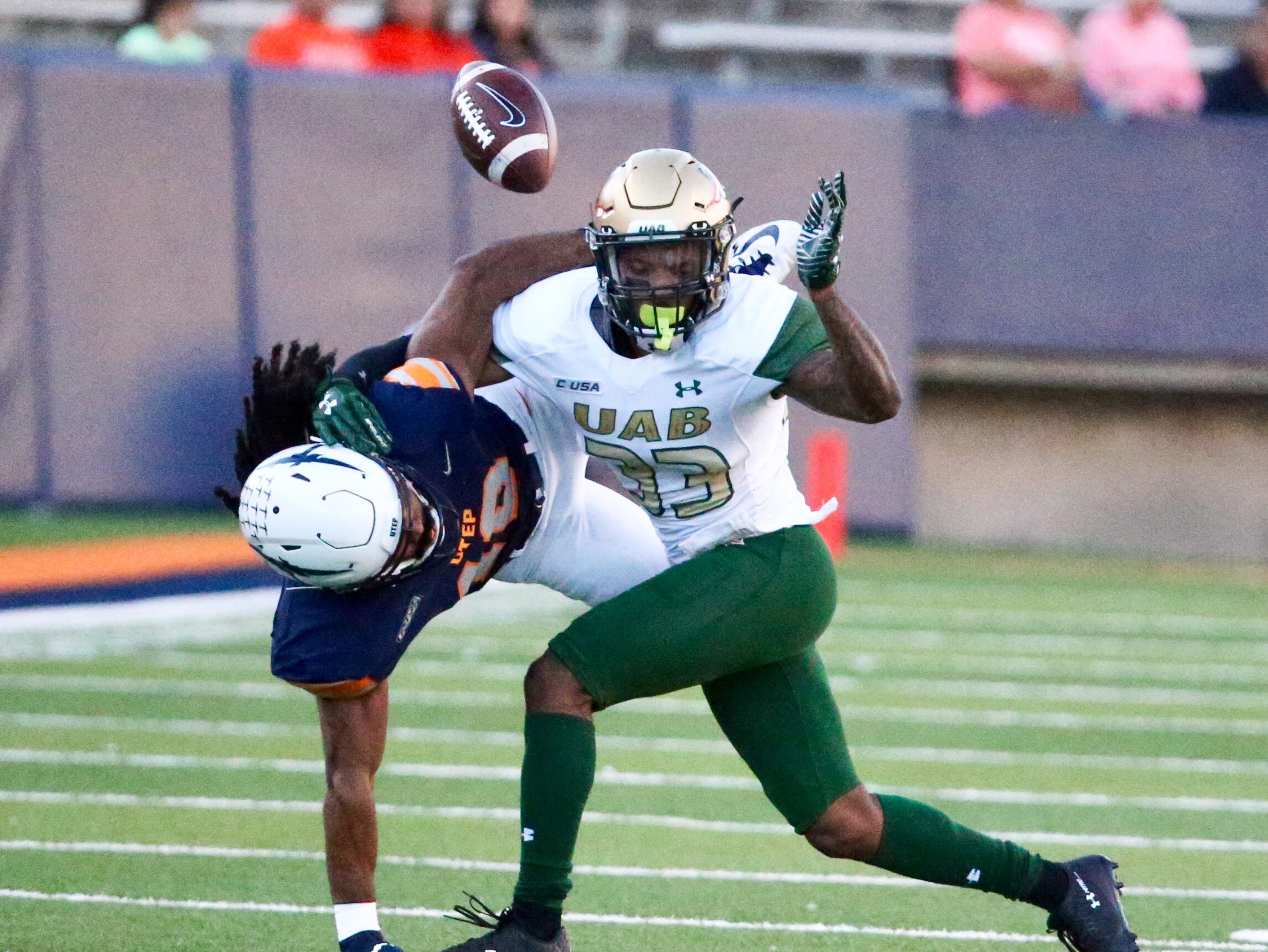 UTEP wide receiver Warren Redix, left, gets wrapped up with UAB's Brontae Harris, 33,  while going for a pass Saturday, Oct. 27 in the Sun Bowl Stadium.