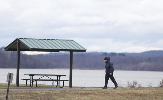 A man walks along the Hudson River at Haverstraw Bay Park in Haverstraw on Tuesday, January 1, 2019.