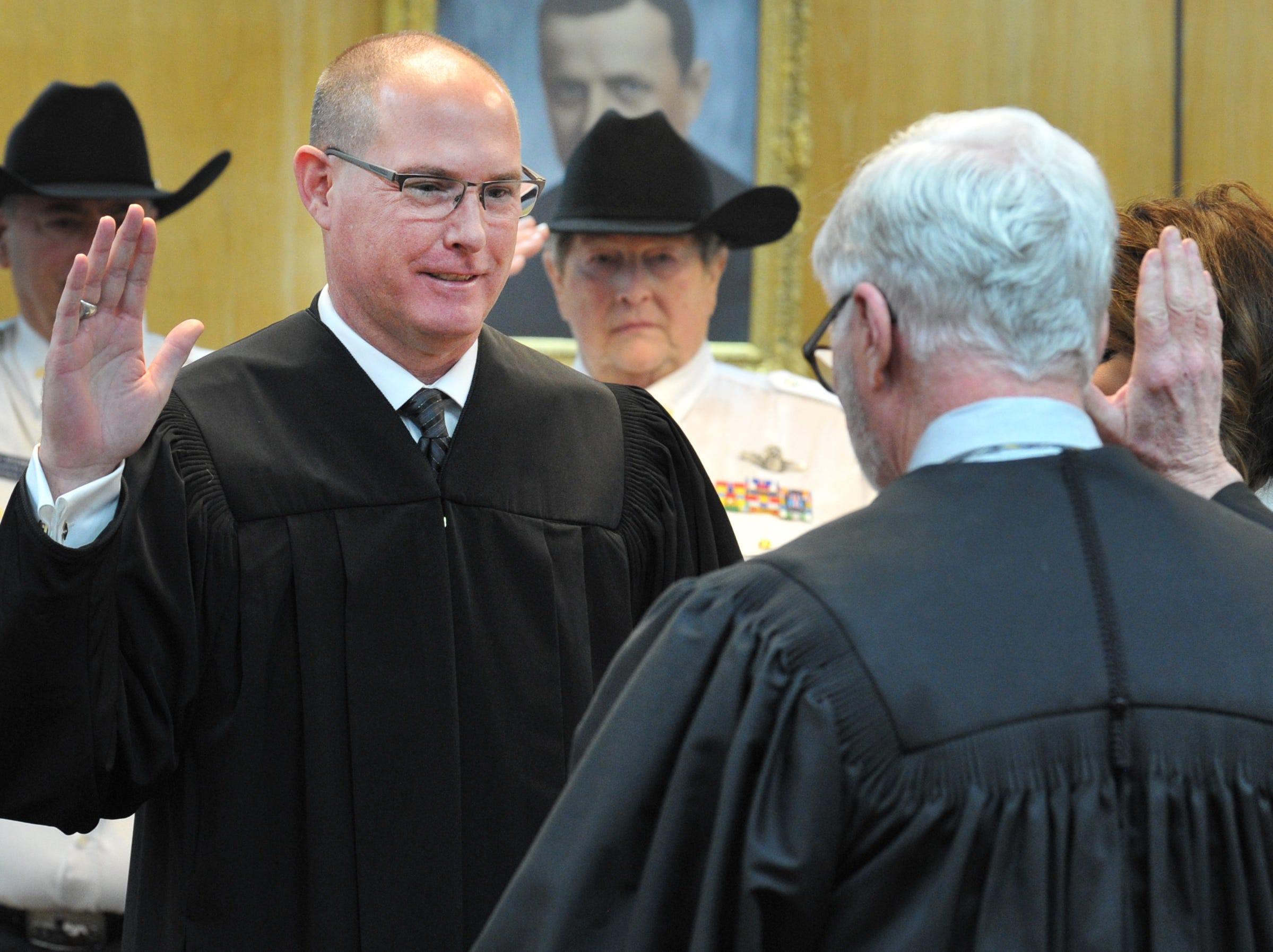 Robert Woodruff was sworn in as Justice of the Peace Precinct 1, Place 1, during a ceremony held in the 30th district courtroom, Tuesday morning.
