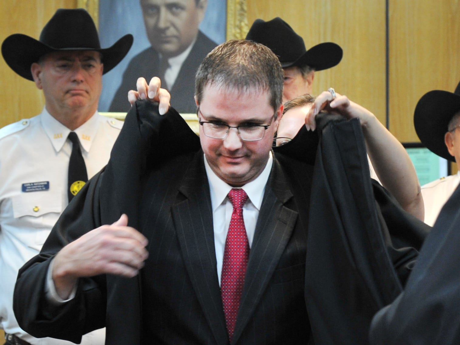 Jeff McKnight accepted his robe after being sworn in as the 30th District Courtroom Judge, Tuesday morning. McKnight sought the judgeship against fellow attorney Dobie Kosub after long-serving Judge Bob Brotherton announced his retirement.