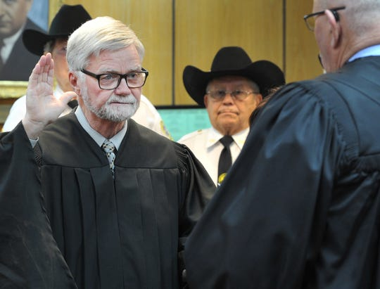 In this file photo, Wichita County Judge Woodrow W. Gossom, Jr. is sworn in for another term during a ceremony held in the 30th district courtroom. Commissioners approved using county funds to retain counsel for a court of inquiry against Gossom.