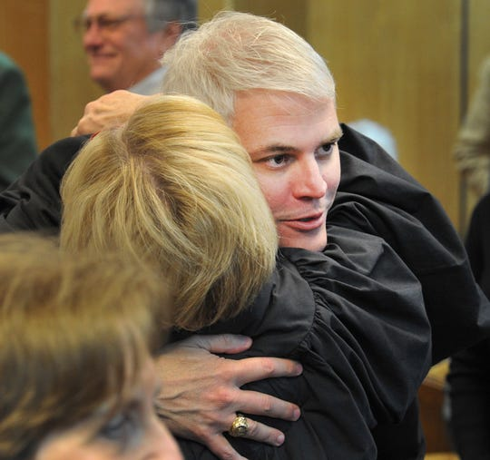 John Gillespie received hugs after being sworn in as the Wichita County District Attorney Tuesday morning in the 30th district courtroom. Gillespie is a former first assistant DA in the county office. He unseated incumbent DA Maureen Shelton in the March Republican primary election.