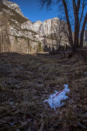 This Monday, Dec. 31, 2018 photo provided by Dakota Snider shows trash tossed on the grounds in Yosemite National Park, Calif.