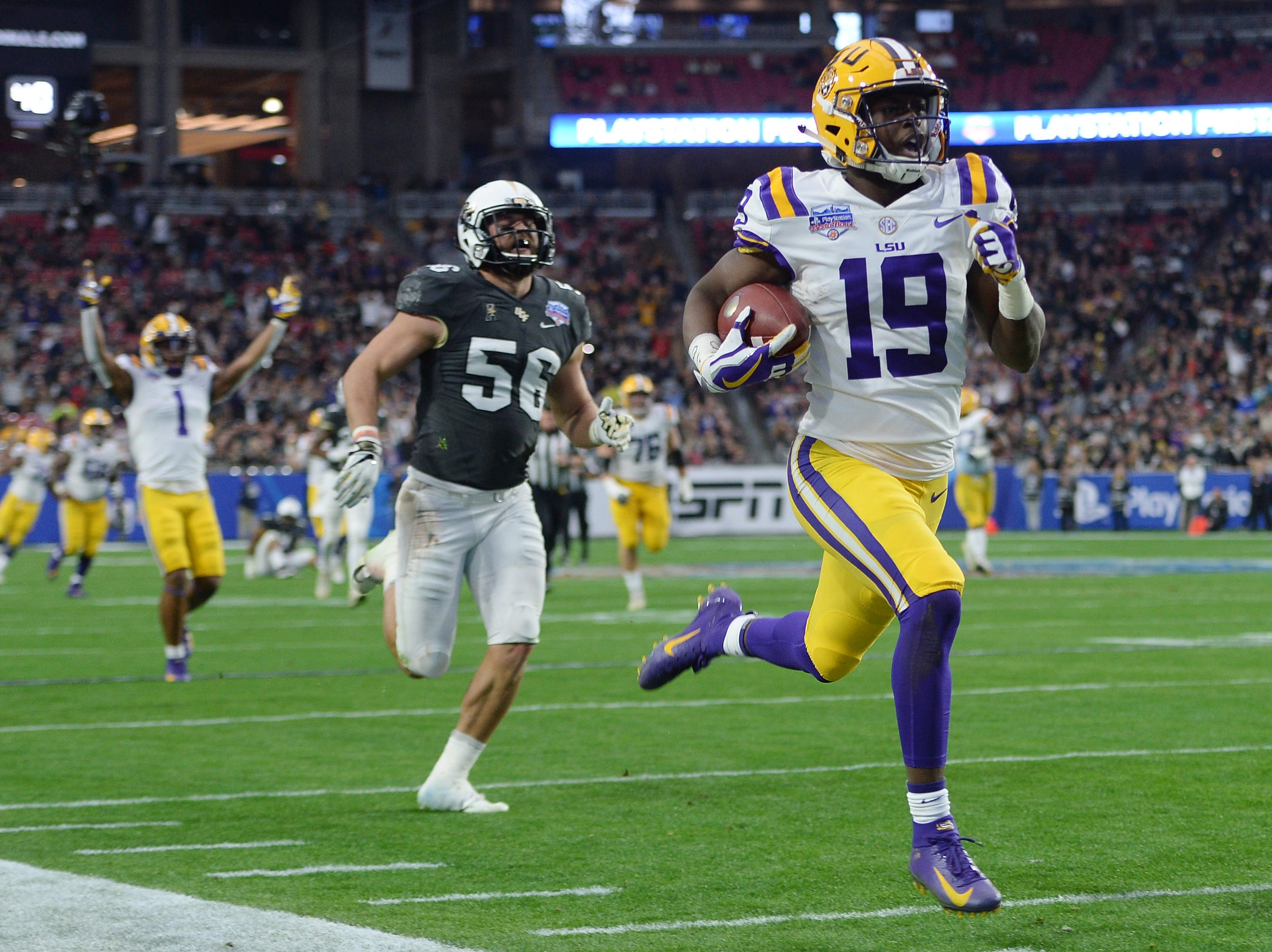 LSU Tigers wide receiver Derrick Dillon (19) scores a touchdown against the UCF Knights during the first half of the Fiesta Bowl.