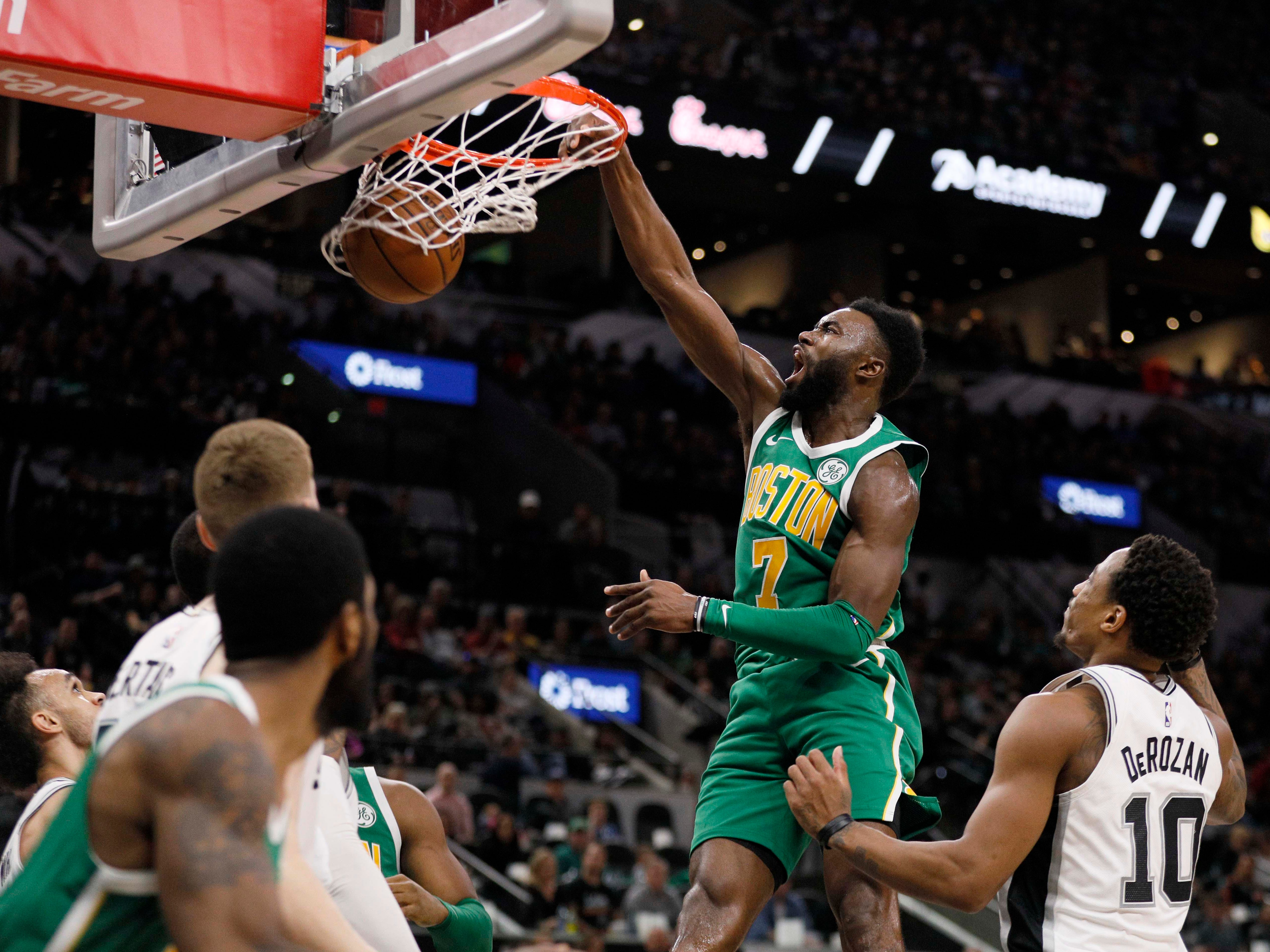 Dec. 31: The Boston Celtics' Jaylen Brown dunks the ball against the San Antonio Spurs during the first half at AT&T Center.