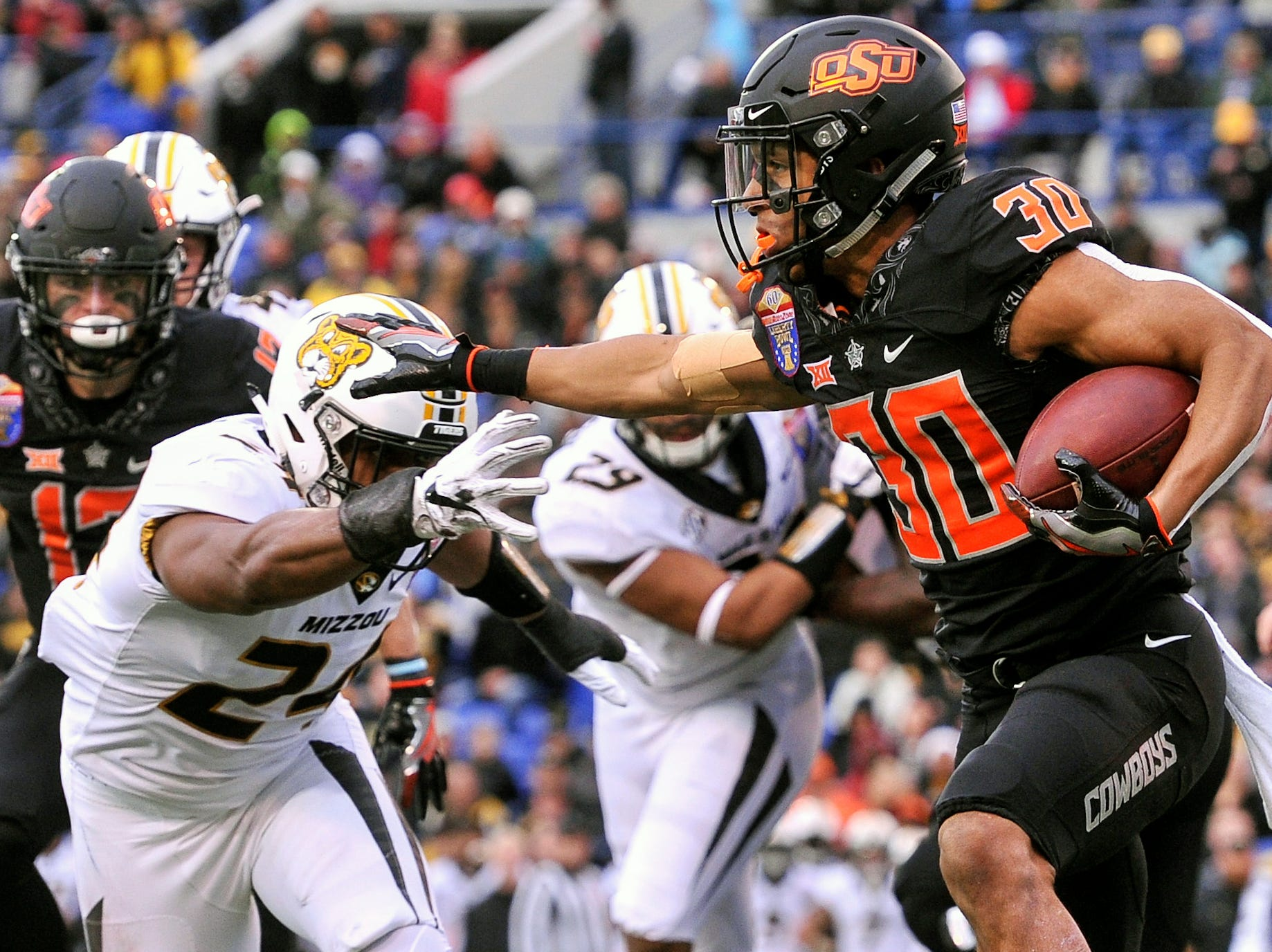 Oklahoma State Cowboys running back Chuba Hubbard (30) carries the ball against Missouri Tigers linebacker Terez Hall (24) during the first half in the Liberty Bowl.