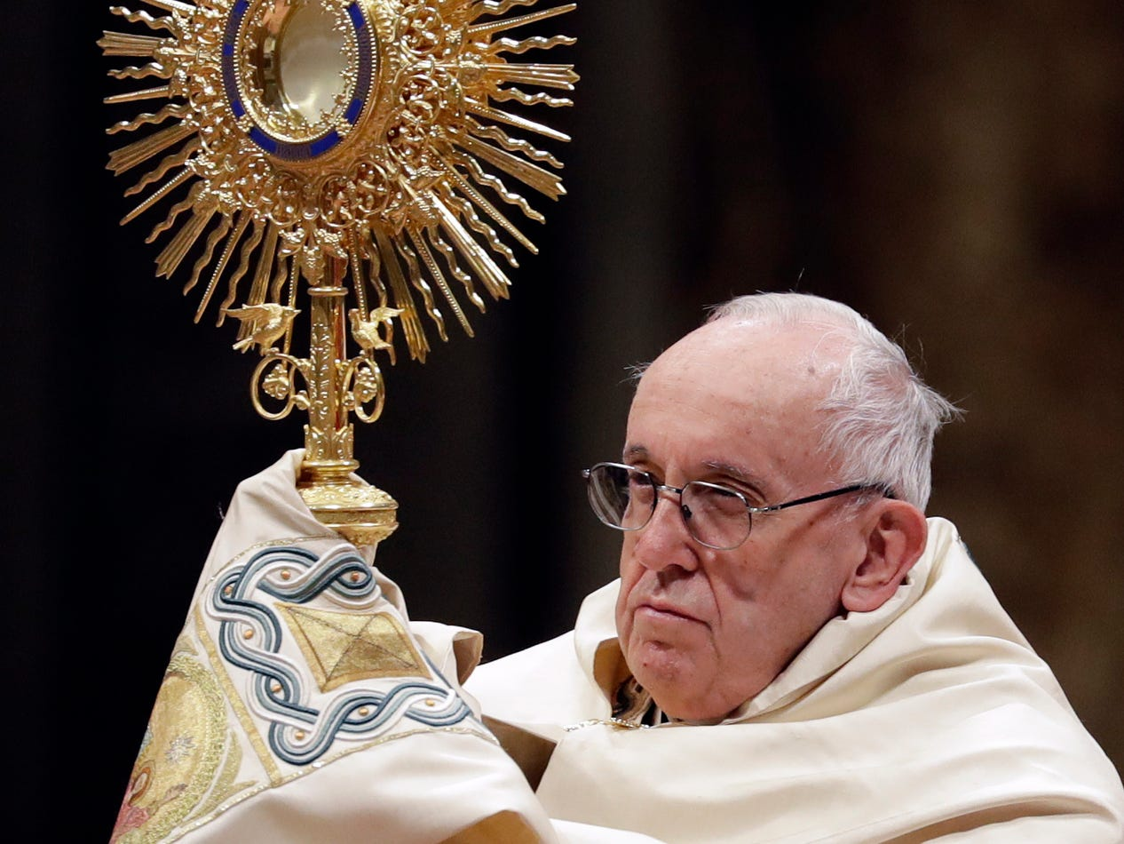 Pope Francis holds a monstrance as he celebrates a new year's eve vespers Mass in St. Peter's Basilica at the Vatican.