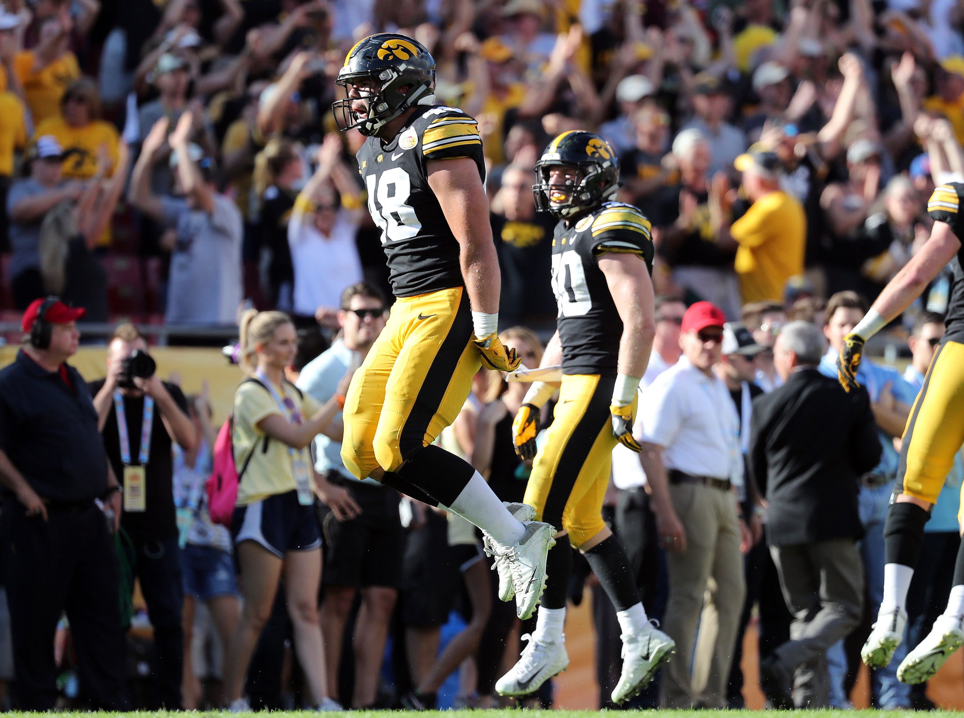 Iowa Hawkeyes linebacker Jack Hockaday (48) and teammates celebrate against the Mississippi State Bulldogs  during the second half of the Outback Bowl.