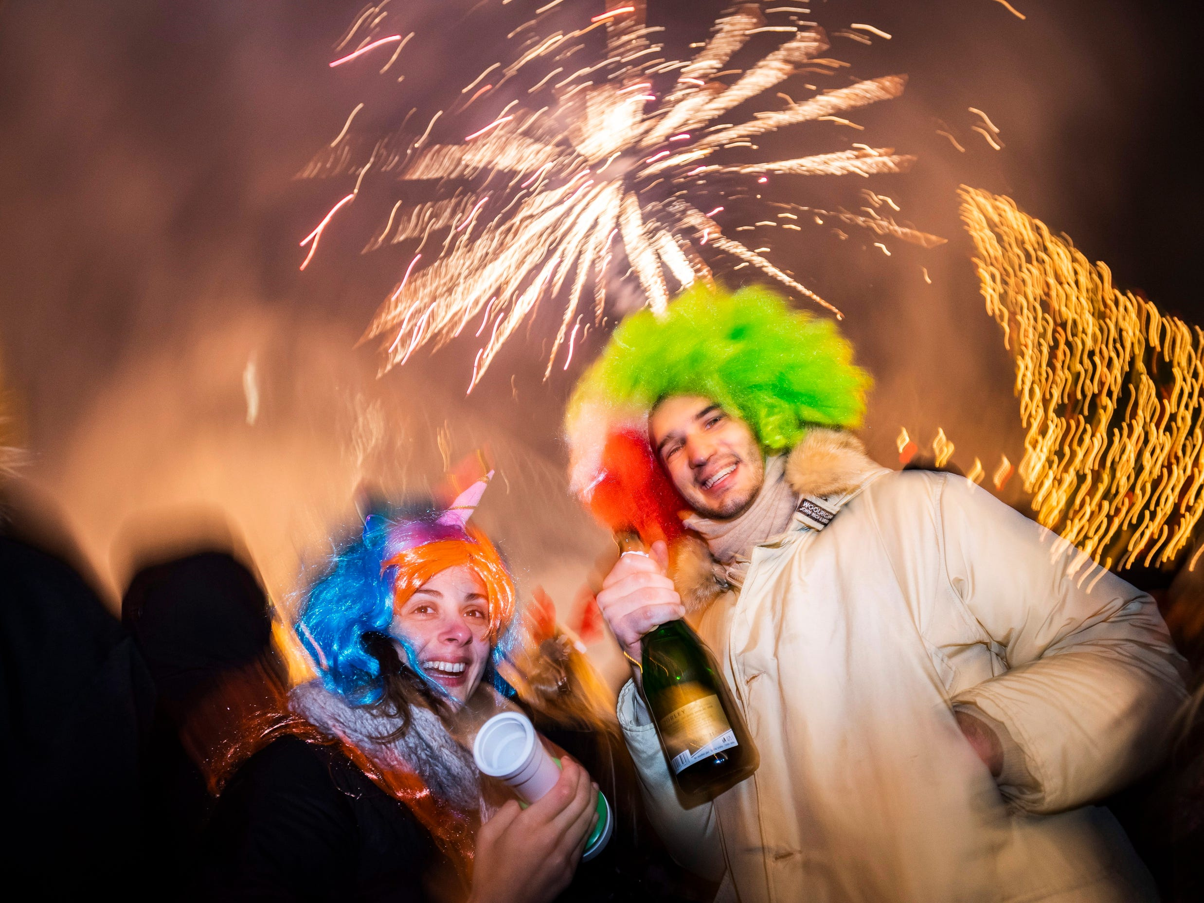 Revellers prepare to welcome the arrival of 2019 during the New Year's Eve celebration on Vorosmarty square, Budapest, Hungary.