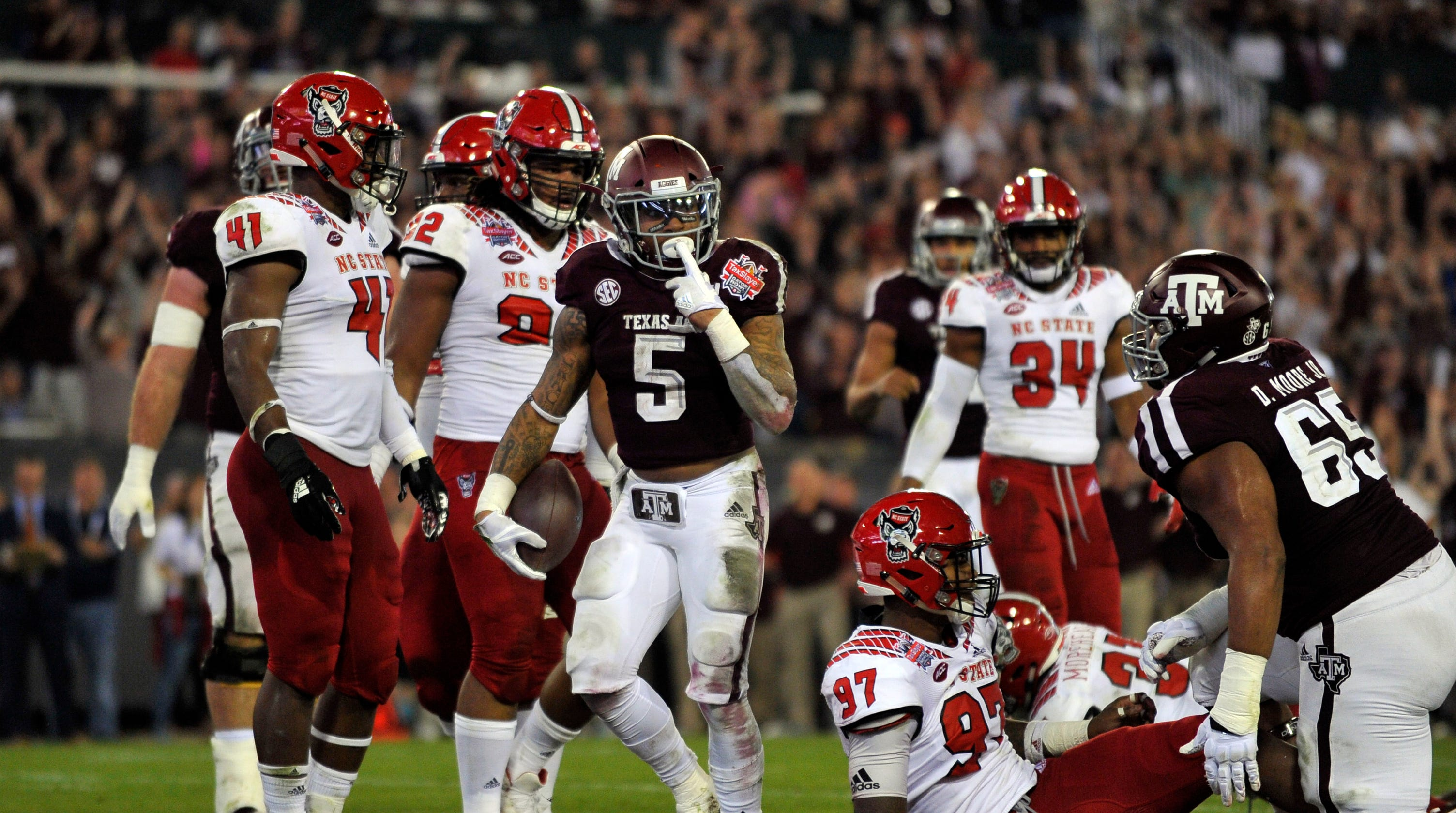 official photos cdc08 4dee5 Gator Bowl  Trayveon Williams powers Texas A M past NC State