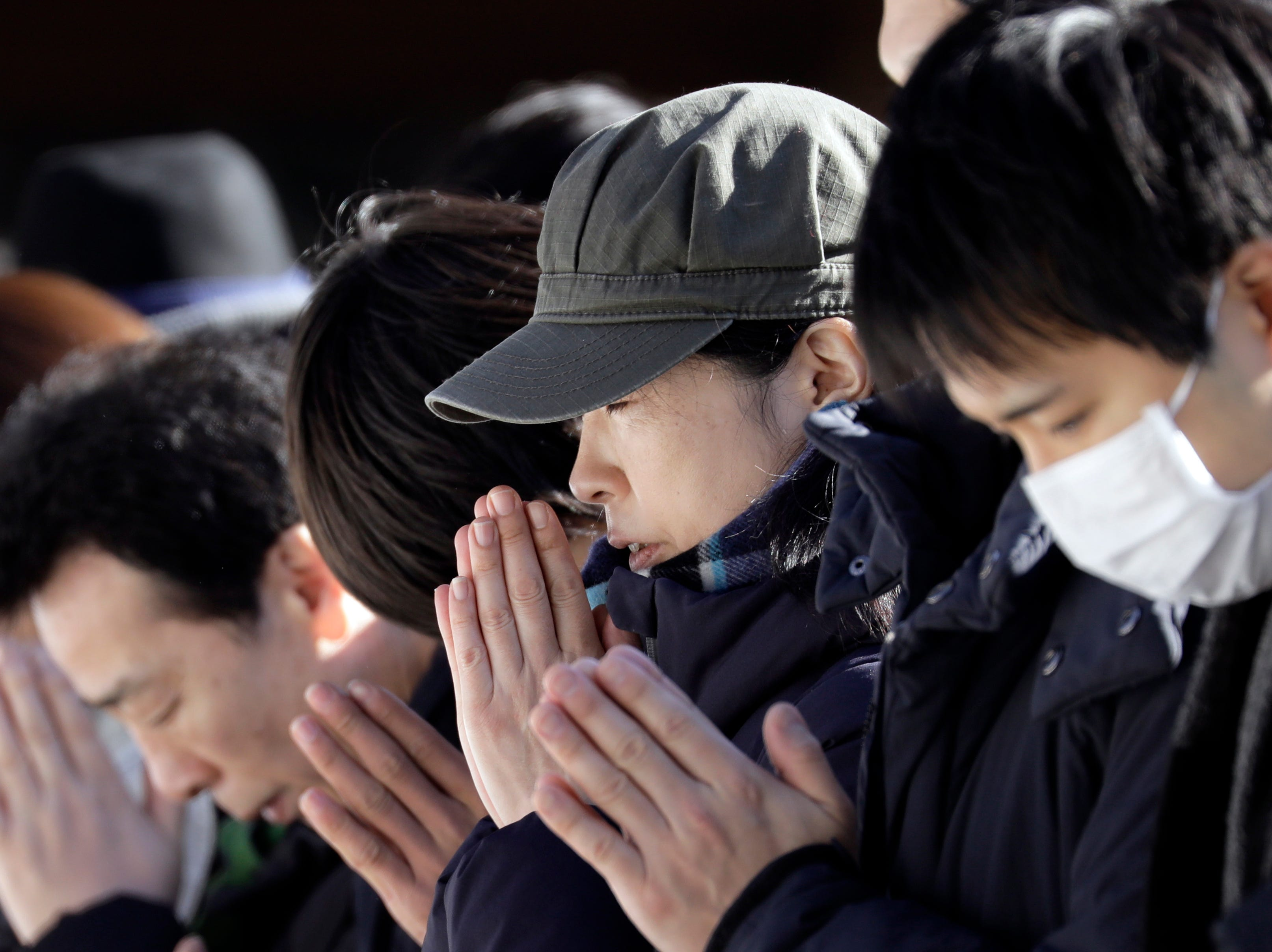 People offer prayers for the new year at Meiji Shrine in Tokyo, Japan on Jan. 1, 2019. More than three million people are expected to visit the shrine to pray for wishes to come true during the first three days of the New Year.
