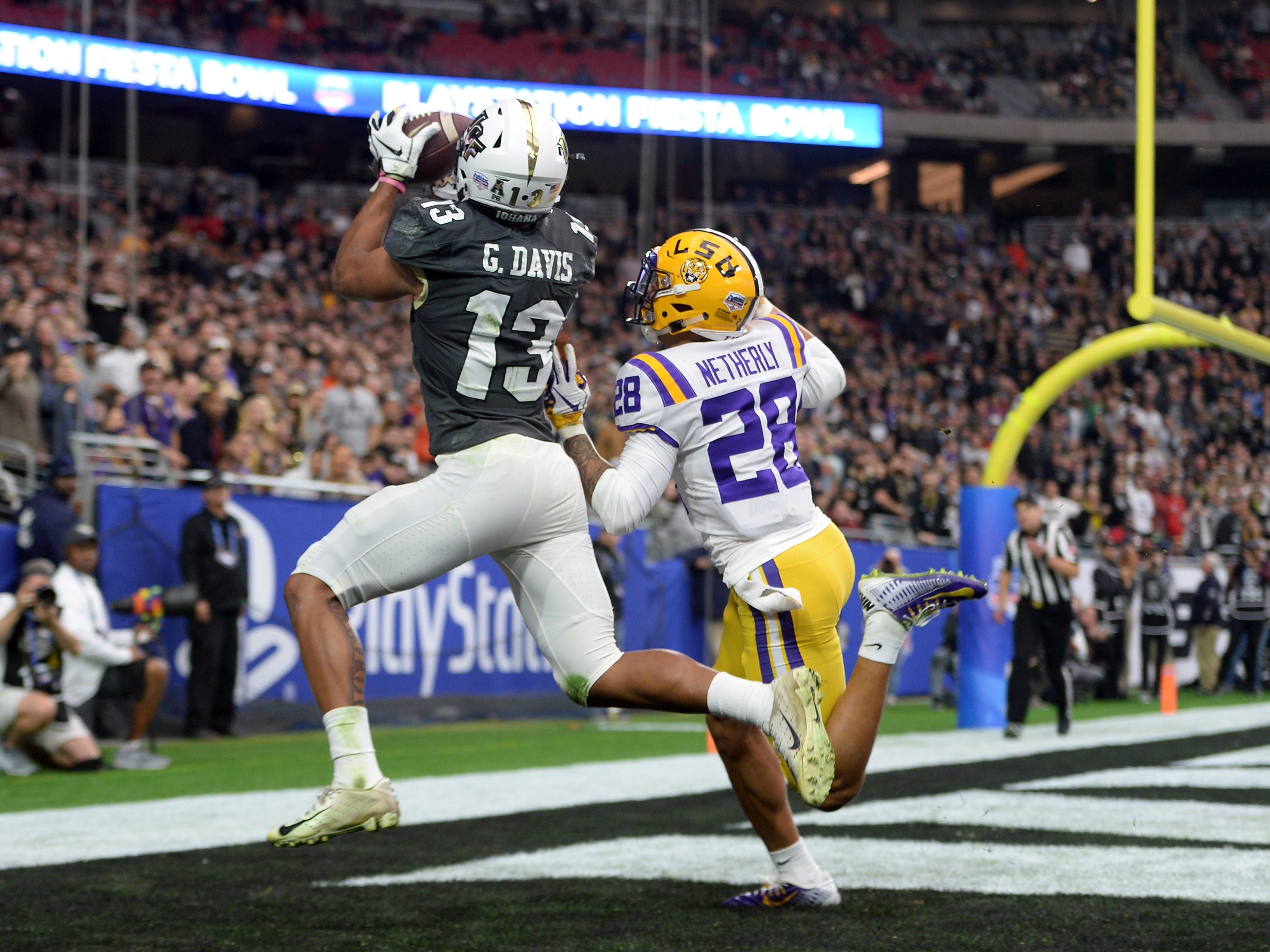 Central wide receiver Gabriel Davis catches a touchdown pass over LSU cornerback Mannie Netherly during the first half of the 2019 Fiesta Bowl.