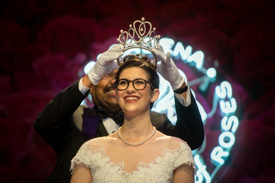 In this Oct. 23, 2018 photo, Tournament of Roses President Gerald Freeny crowns Rose Queen Louise Deser Siskel at the Pasadena Playhouse. Final preparations are marching forward for the 130th Rose Parade, with forecasters warning thousands of spectators to expect frigid, blustery weather in Southern California. (Sarah Reingewirtz/The Orange County Register via AP) ORG XMIT: CAANR101