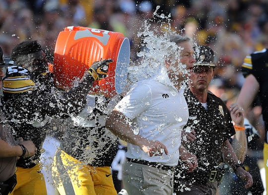Iowa coach Kirk Ferentz gets water poured on him after the Hawkeyes beat Mississippi State in the 2019 Outback Bowl.