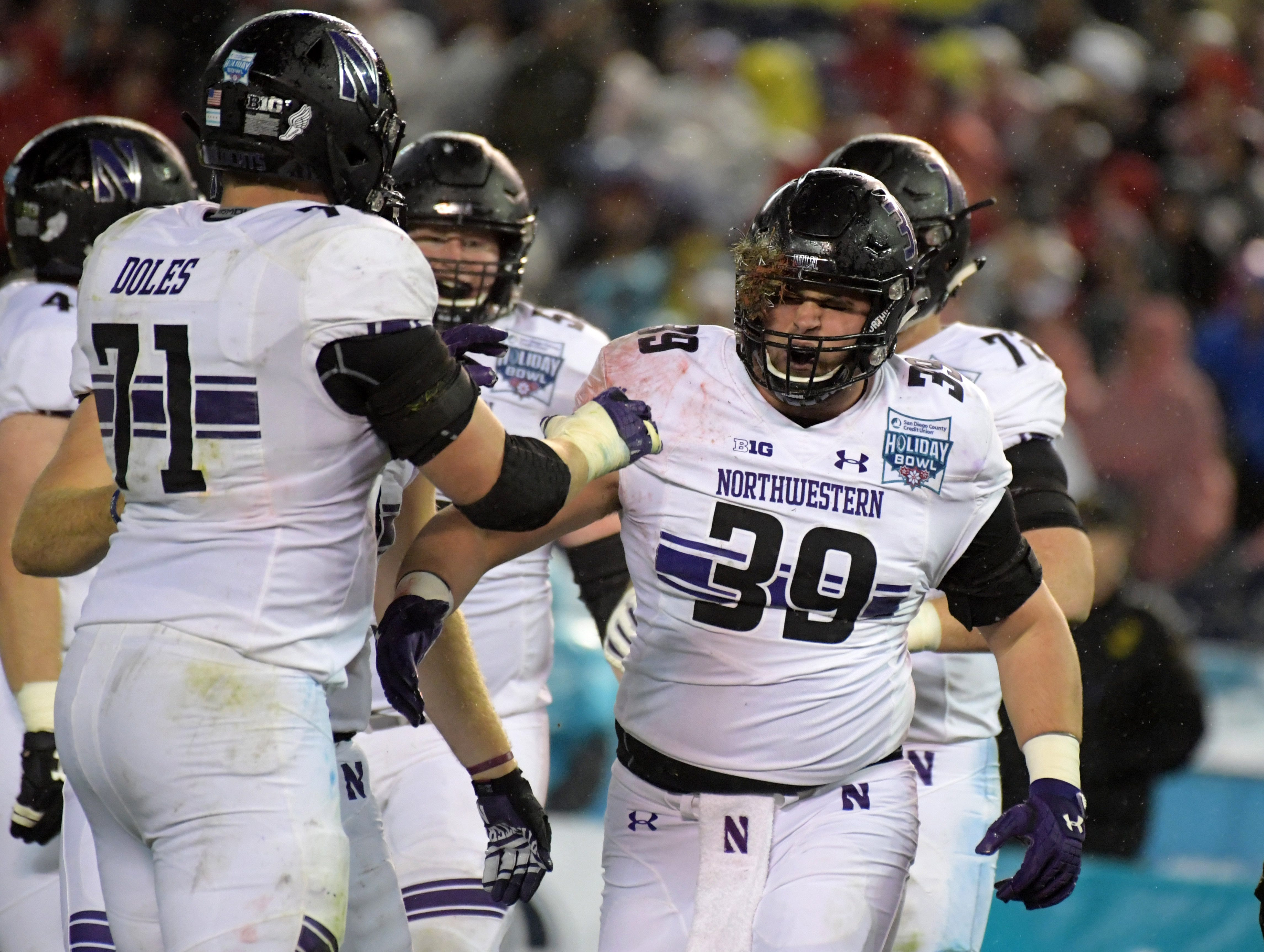 Northwestern Wildcats offensive lineman Trey Klock (39) celebrates after a touchdown reception against the Utah Utes in the Holiday Bowl.