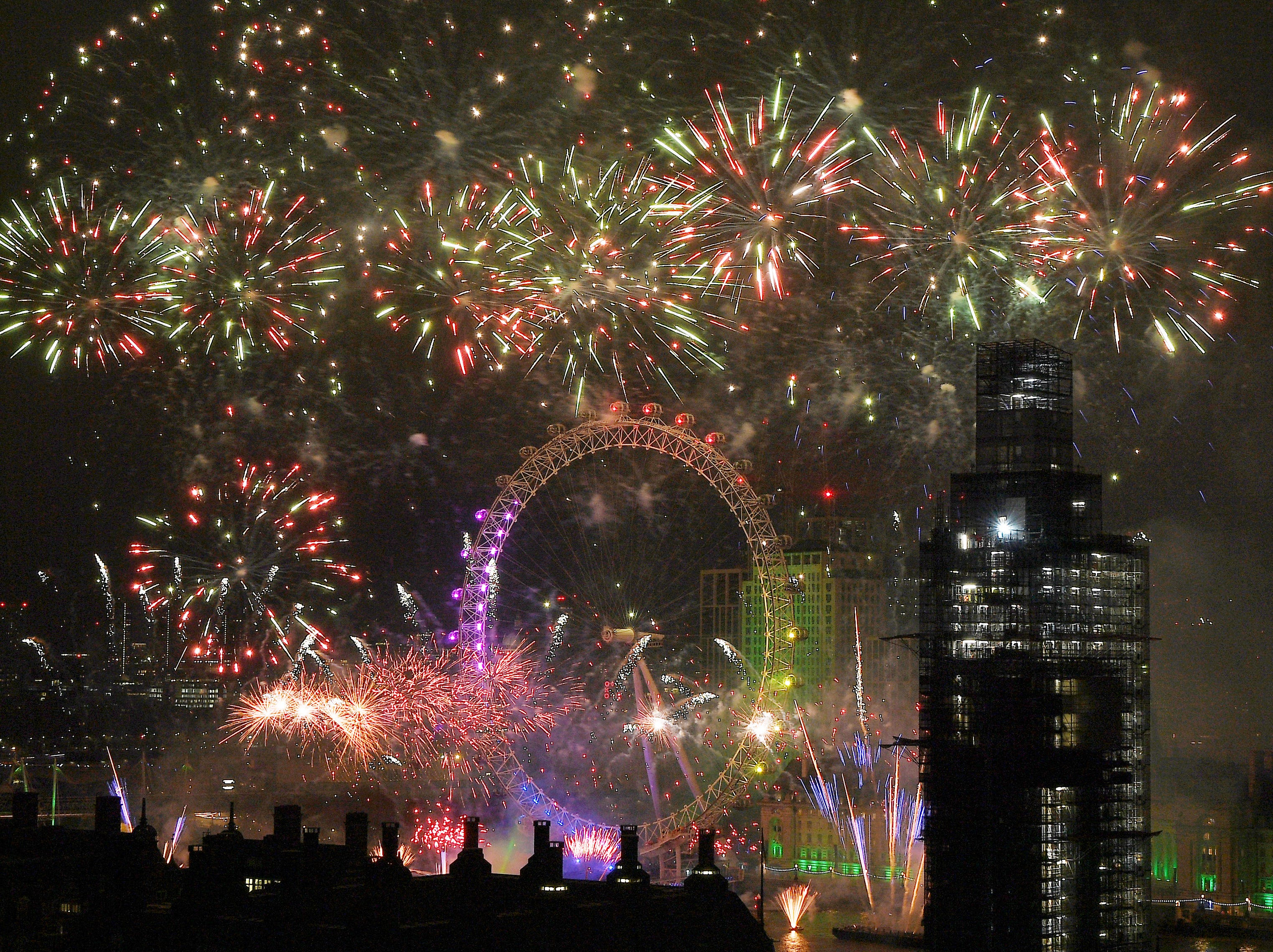 Fireworks explode over Westminster Abbey and Elizabeth Tower near Parliament as thousands of revelers gather along the banks of the River Thames to ring in the New Year on Jan. 1, 2019 in London, England. Parliament confirmed that after being silenced for renovation work since 2017, Big Ben's famous bongs would ring out at midnight again to welcome in 2019.