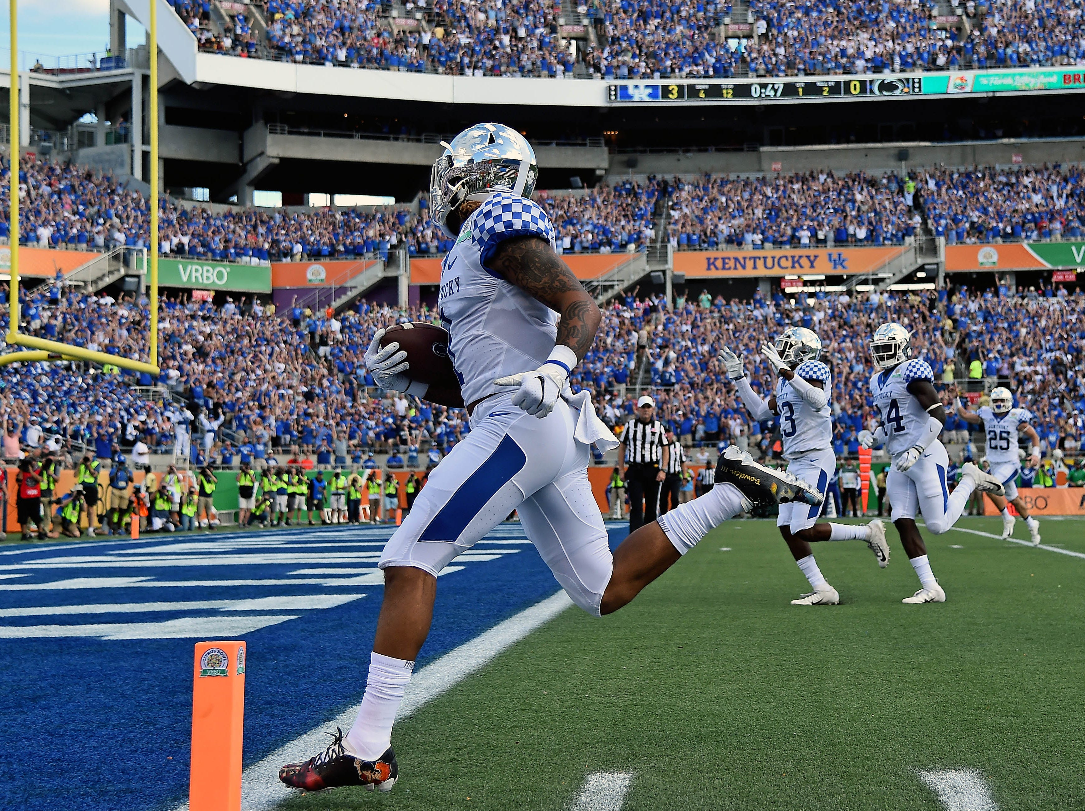 Kentucky returns a punt for a touchdown against Penn State during the first half of the Citrus Bowl.
