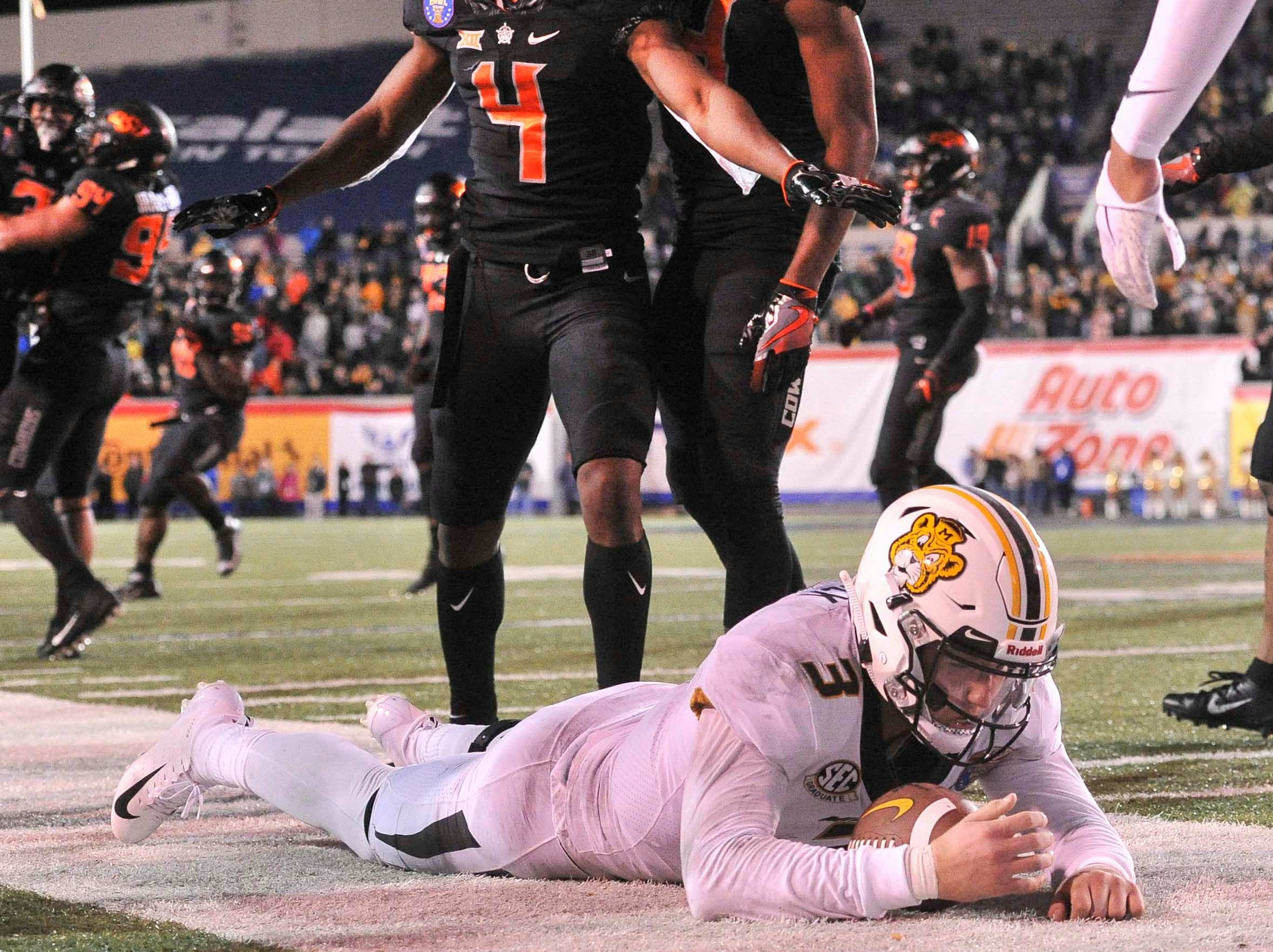 Missouri Tigers quarterback Drew Lock (3) reacts during the second half against the Oklahoma State Cowboys in the Liberty Bowl.
