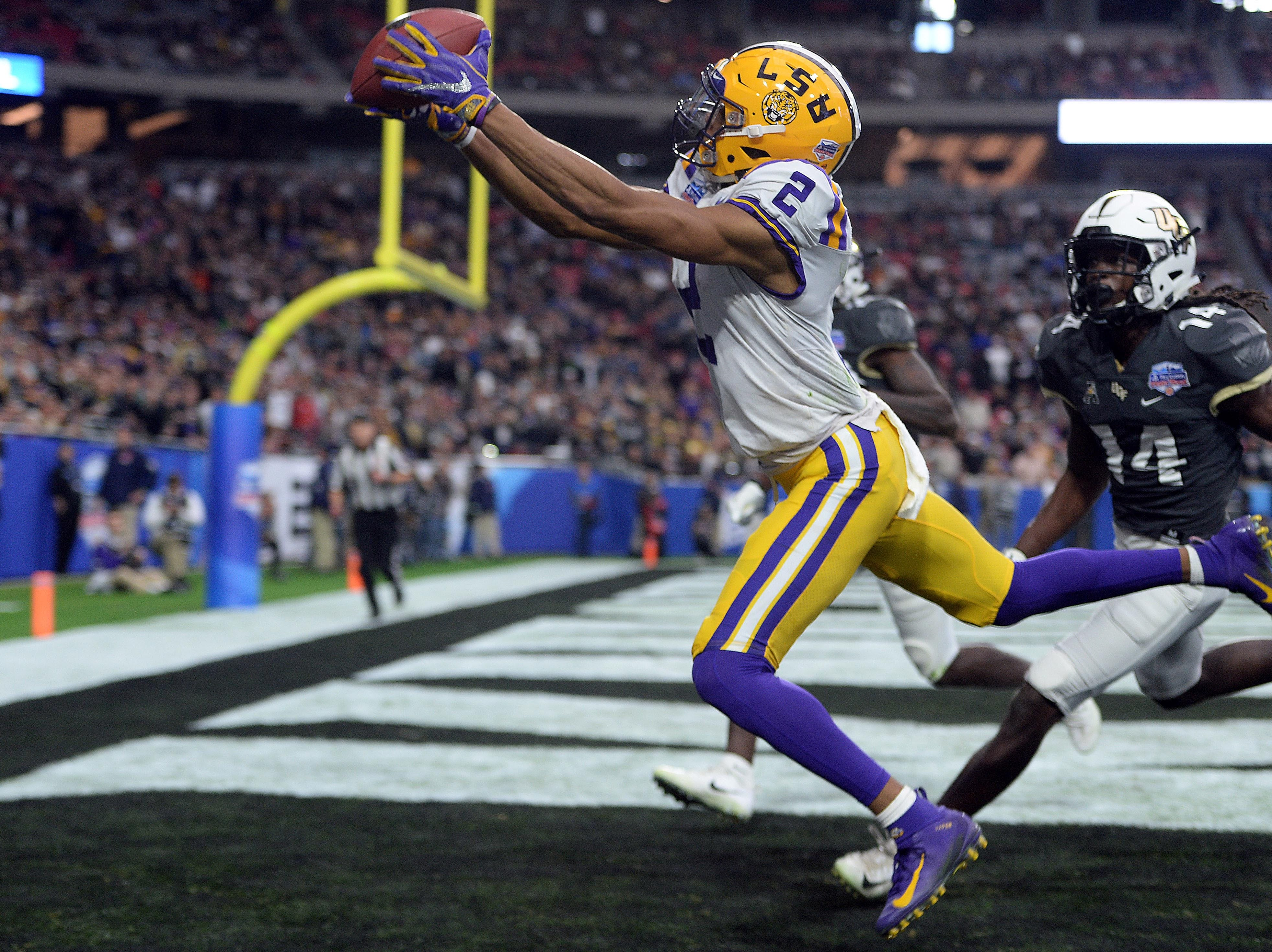 LSU Tigers wide receiver Justin Jefferson (2) catches a touchdown pass against the UCF Knights during the first half of the Fiesta Bowl.