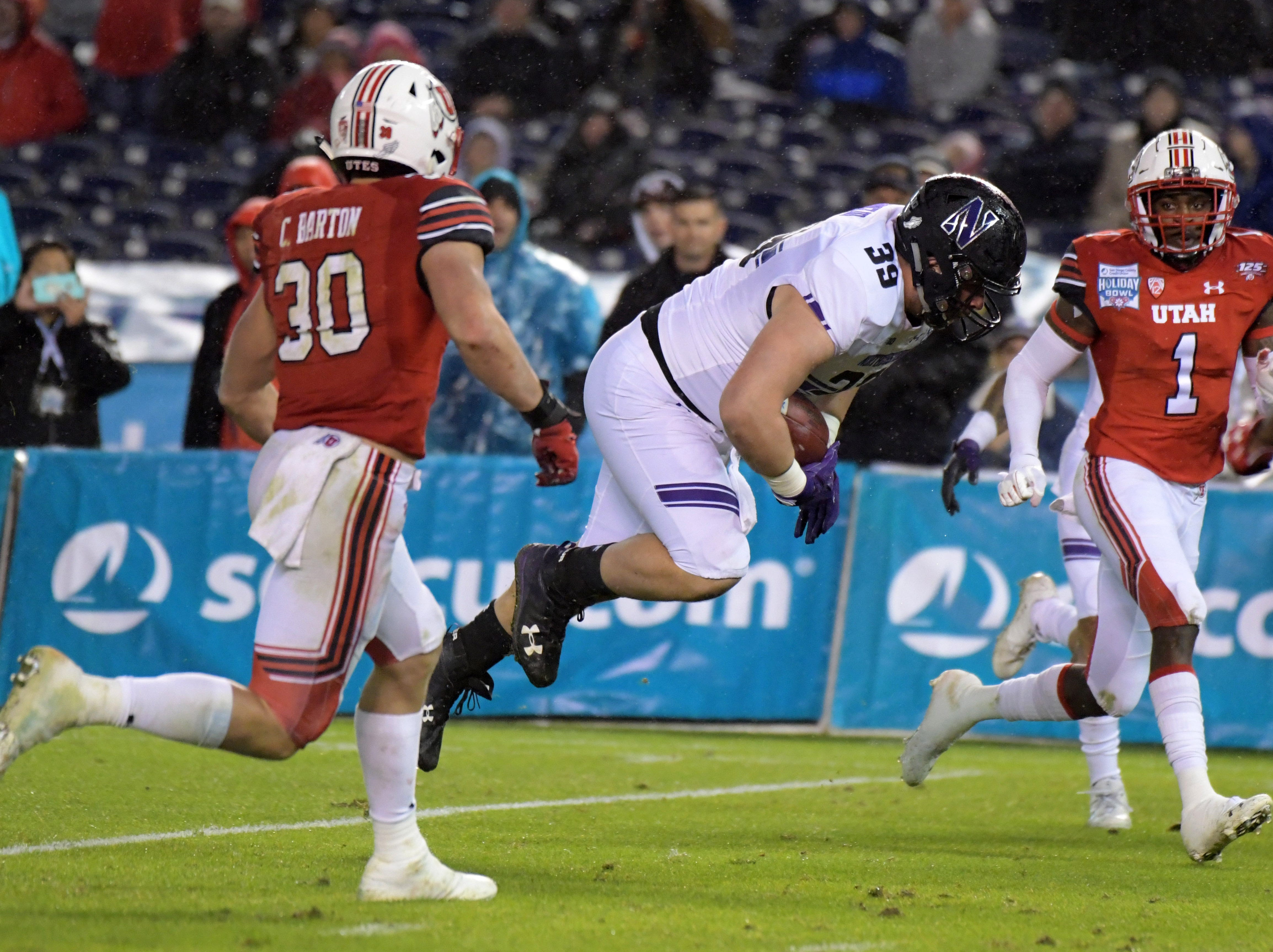 Northwestern Wildcats offensive lineman Trey Klock (39) scores on a 20-yard touchdown reception against the Utah Utes in the Holiday Bowl.