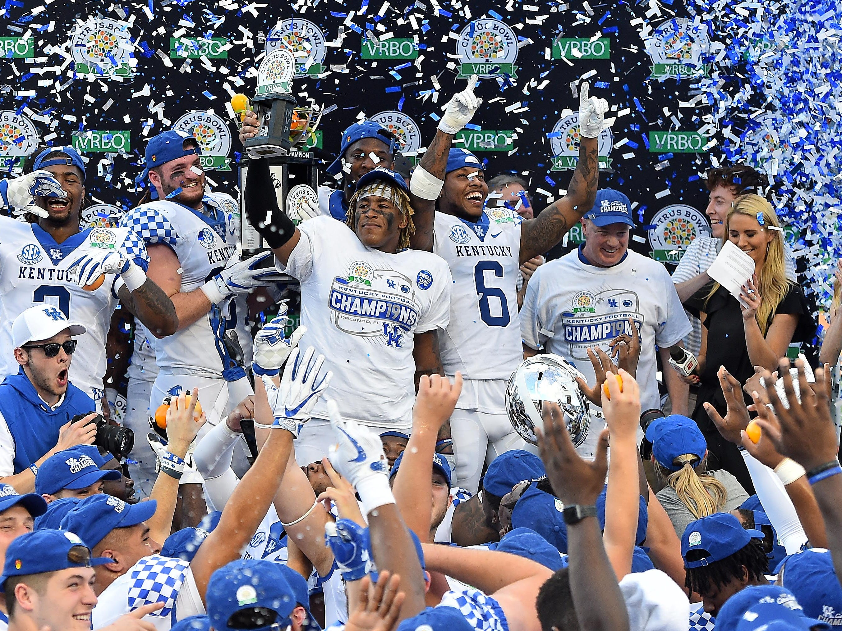 Kentucky players celebrate after defeating the Penn State in the 2019 Citrus Bowl.