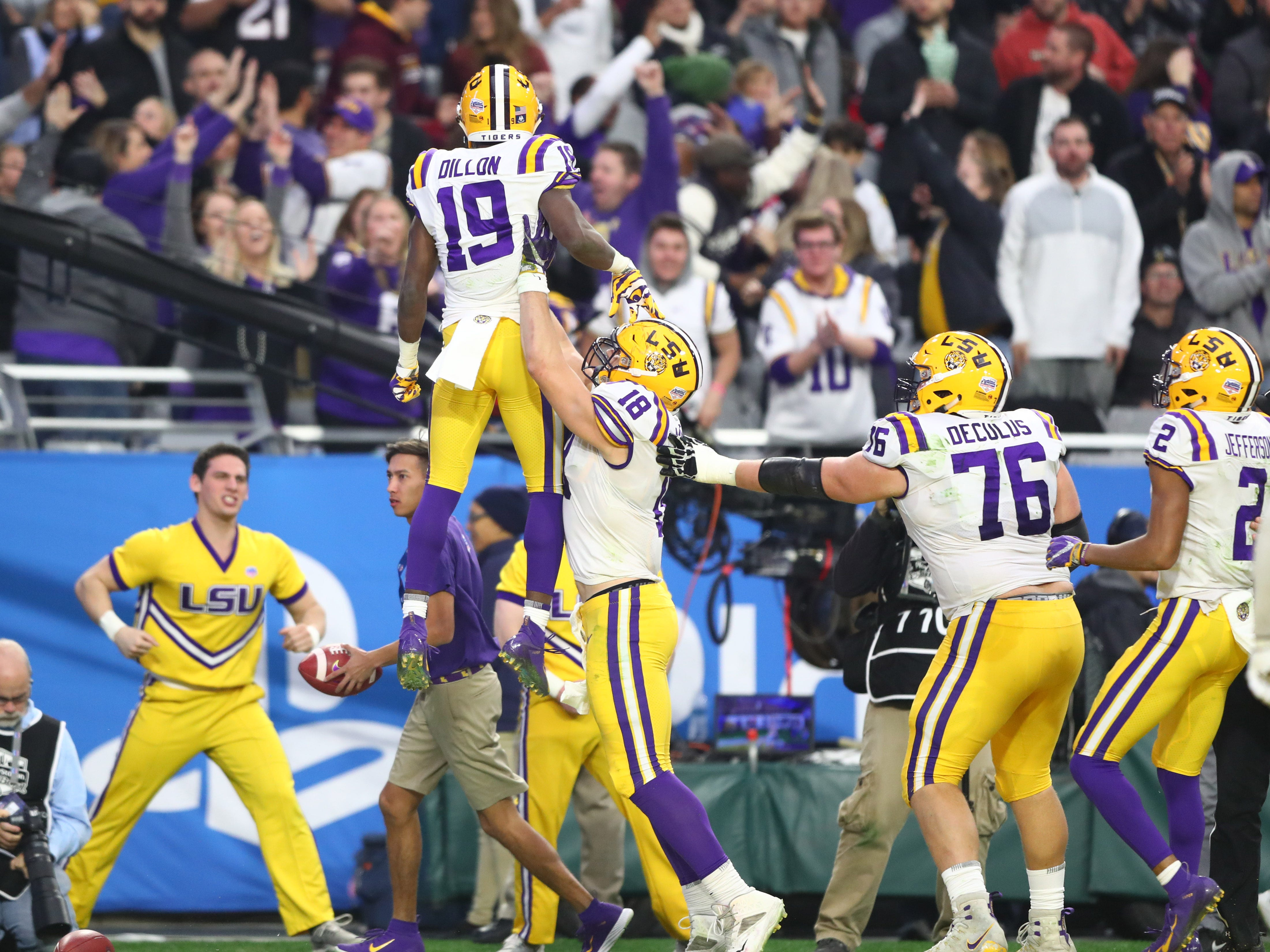 LSU wide receiver Derrick Dillon celebrates after catching a touchdown pass against Central Florida in the 2019 Fiesta Bowl.