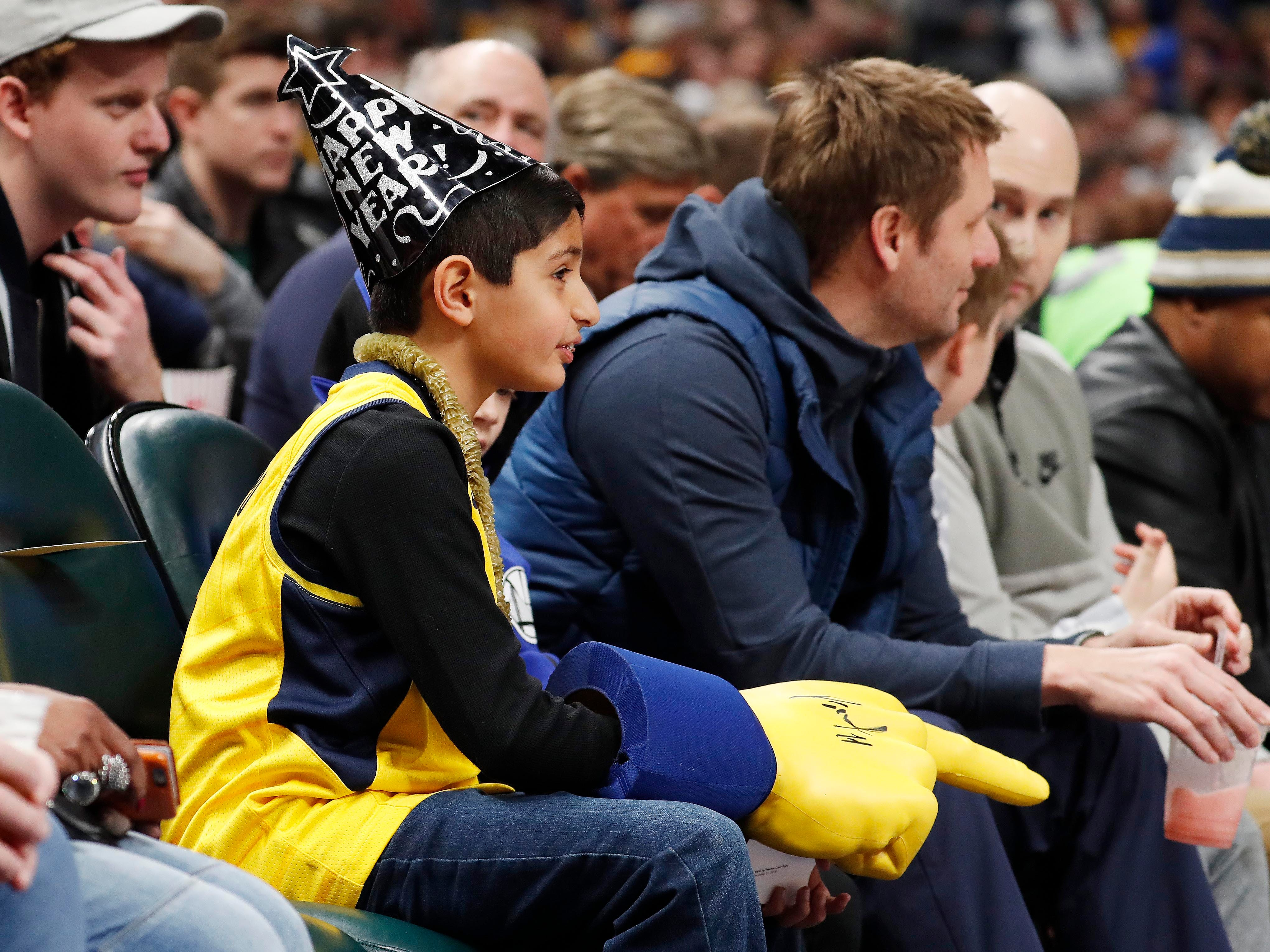 Dec. 31: An Indiana Pacers fan with a Happy New Year hat watches the game against the Atlanta Hawks at Bankers Life Fieldhouse.