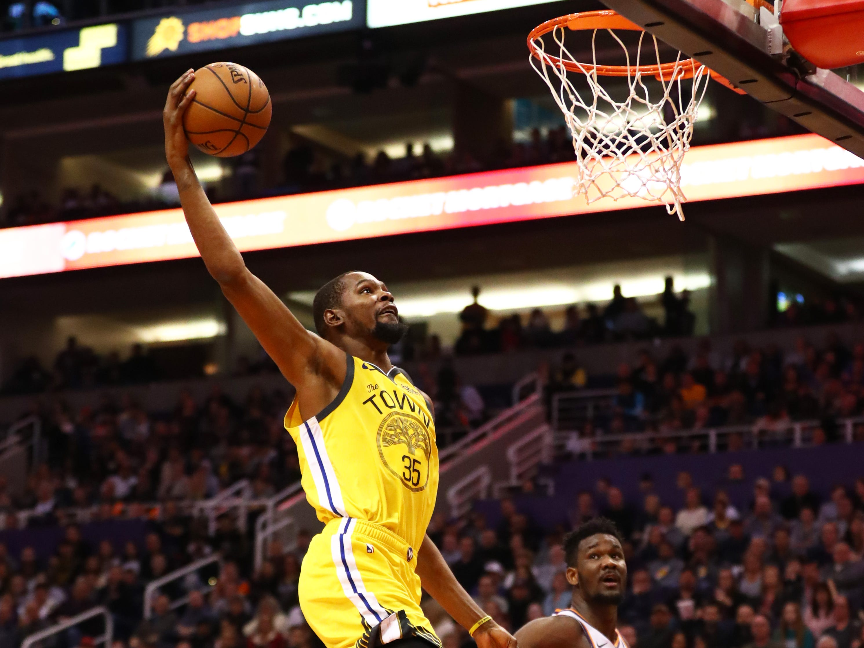 Dec. 31: The Golden State Warriors' Kevin Durant  slam dunks against the Phoenix Suns at Talking Stick Resort Arena.