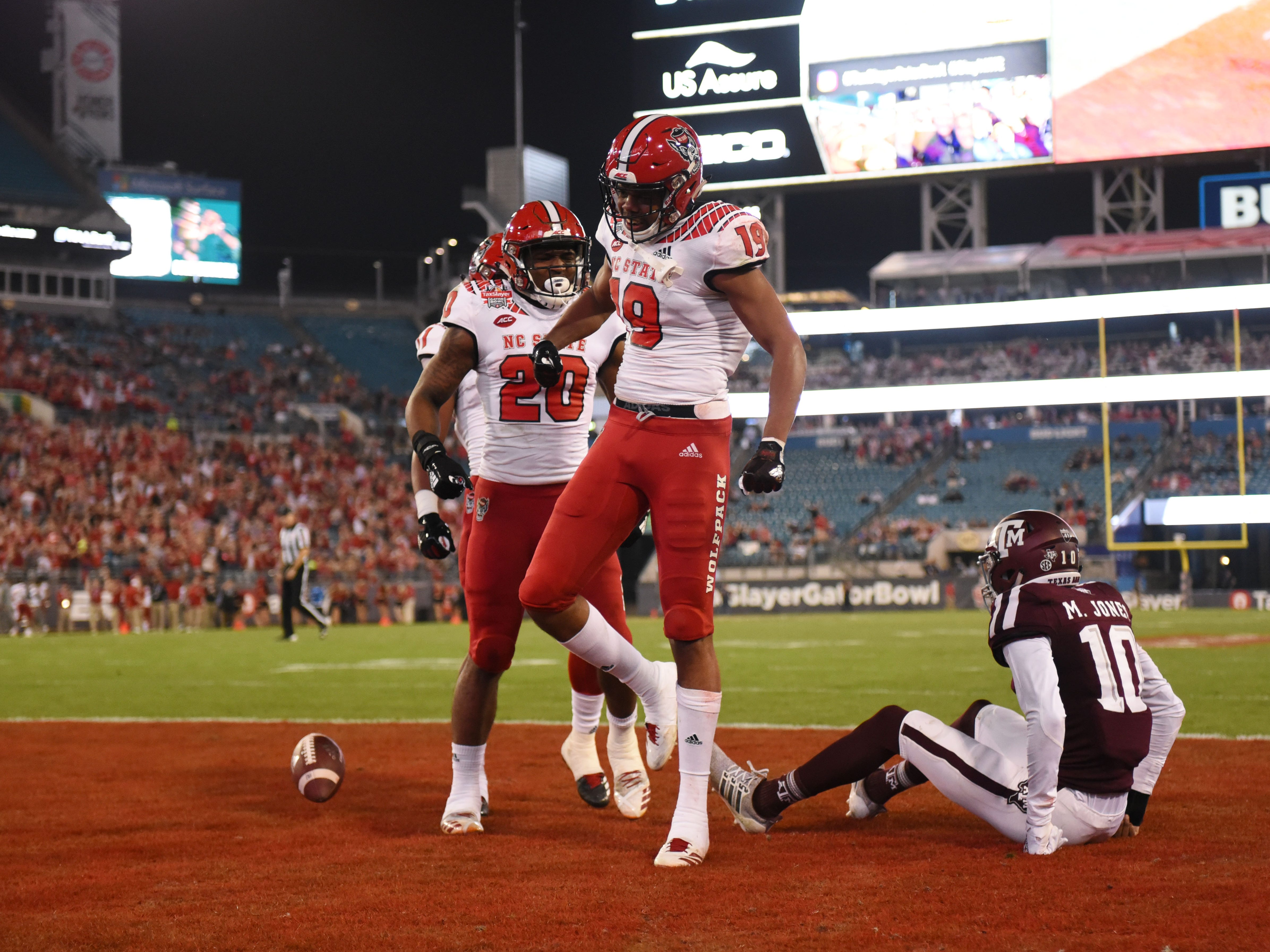 North Carolina State Wolfpack wide receiver C.J. Riley (19) celebrates after scoring a touchdown against the Texas A&M Aggies during the second quarter of the Gator Bowl.