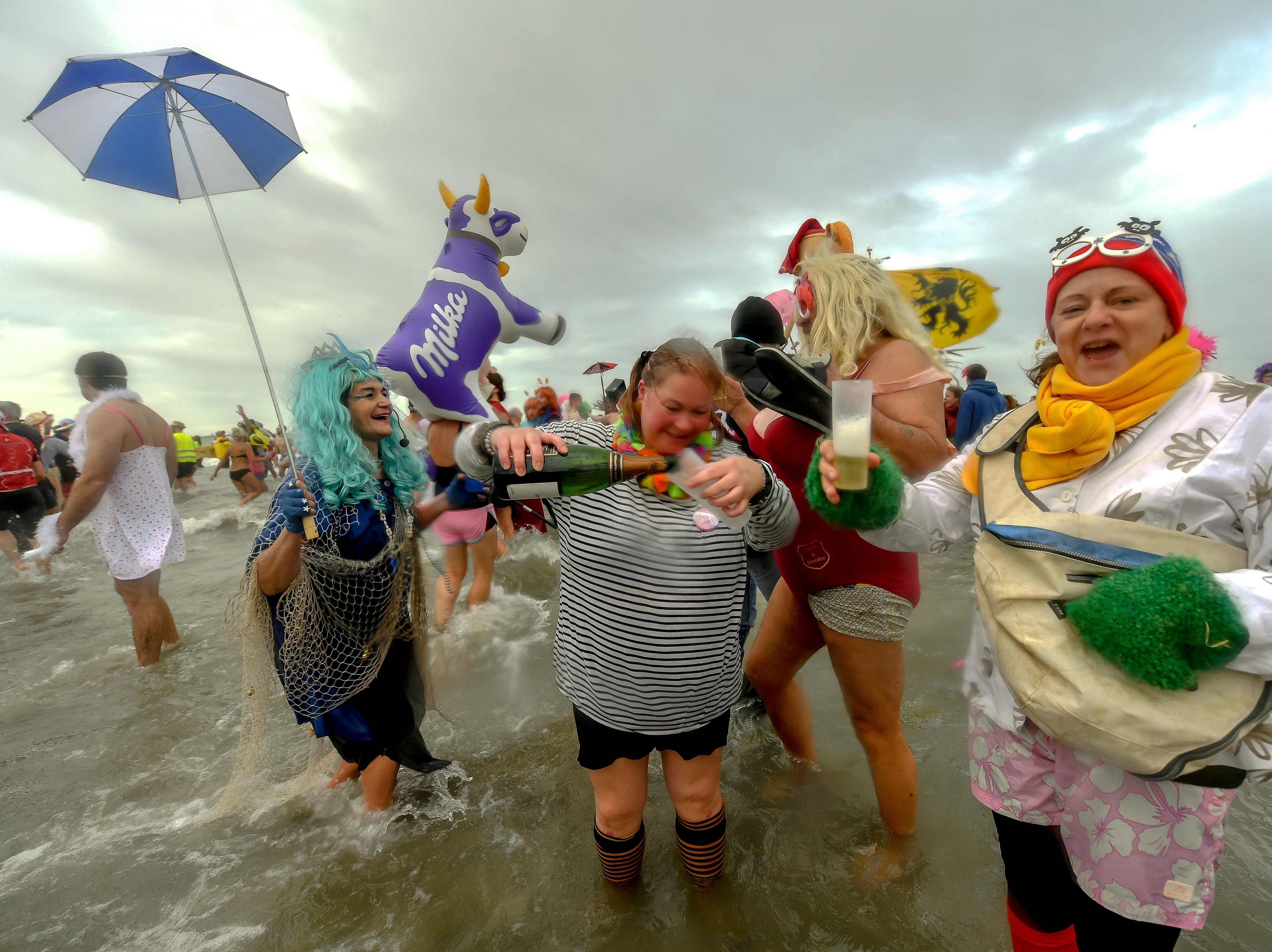 """Revelers take part in the traditional """"Bain des Givres"""" as part of the New Year's celebrations on Jan. 1, 2019 at Malo-Les-Bains beach in Dunkirk, northern France."""