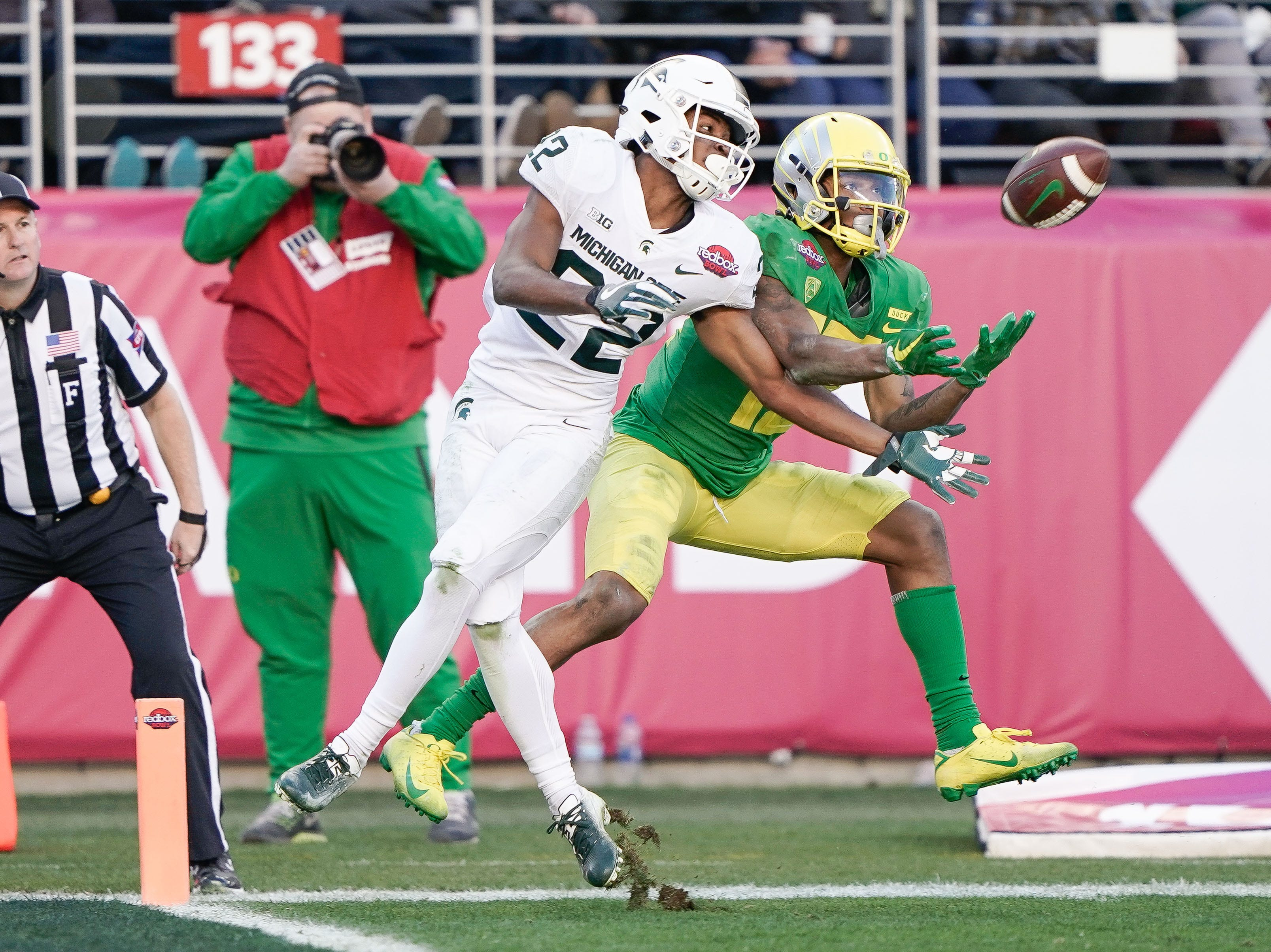 Michigan State Spartans cornerback Josiah Scott (22) battles Oregon Ducks wide receiver Dillon Mitchell (13) for a pass during the fourth quarter of the Redbox Bowl.