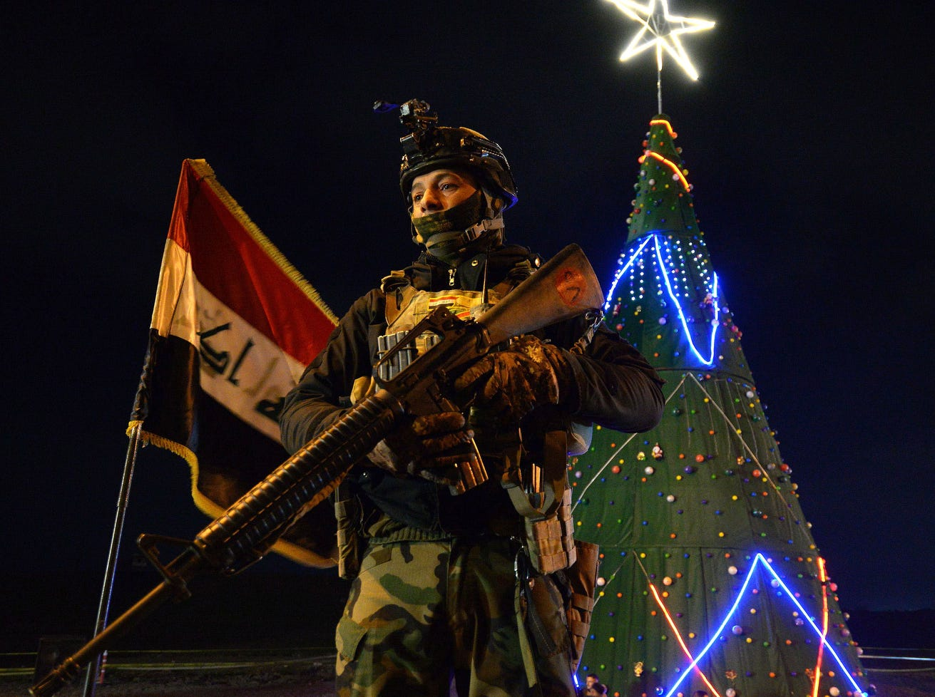 An Iraqi soldier stands guard the street during celebrations for new year's eve in Mosul on Dec. 31, 2018.