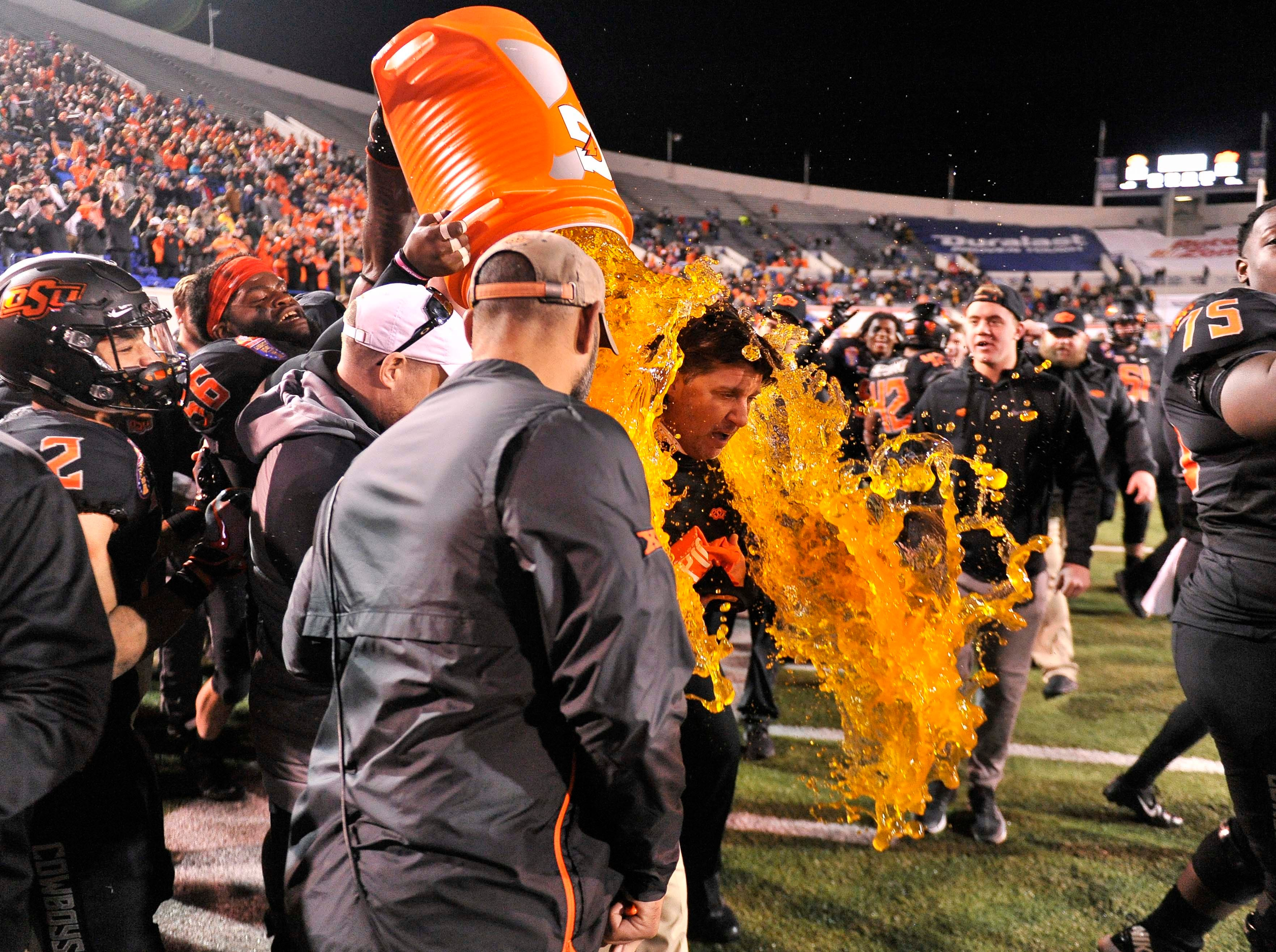 Oklahoma State Cowboys head coach Mike Gundy is doused after the Liberty Bowl win against the Missouri Tigers.