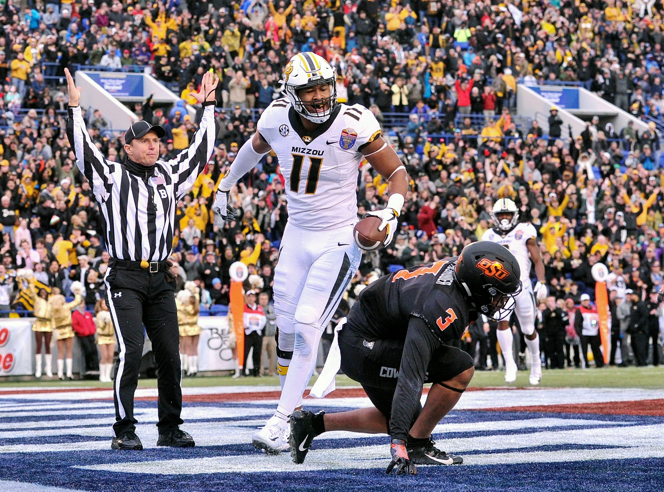 Missouri Tigers tight end Kendall Blanton (11) celebrates during the first half against the Oklahoma State Cowboys in the Liberty Bowl.