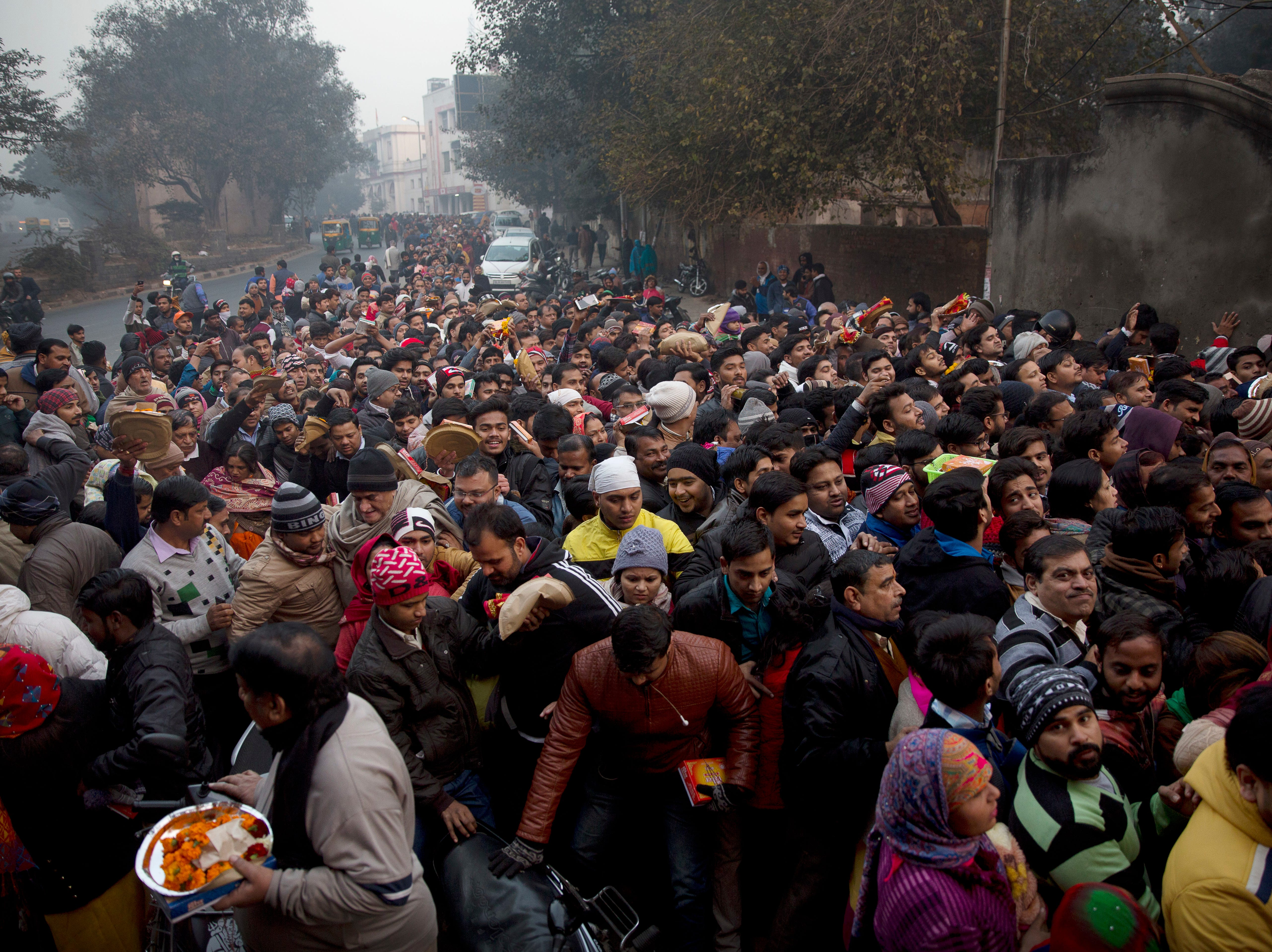 Indians throng to offer prayers in a temple on the first day of the new year in New Delhi, India, Tuesday, Jan. 1, 2019. (AP Photo/Manish Swarup) ORG XMIT: XMS102