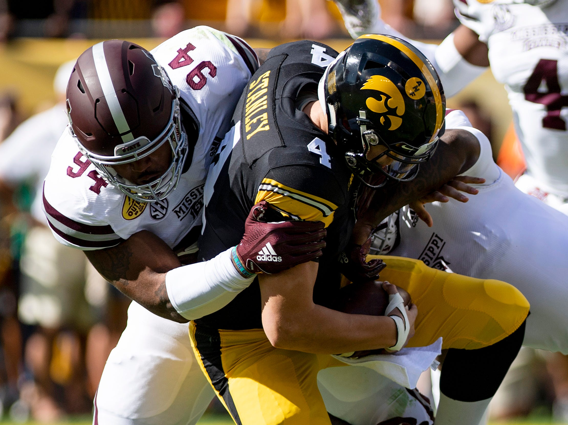 Iowa Hawkeyes quarterback Nate Stanley (4) is sacked by Mississippi State Bulldogs defensive tackle Jeffery Simmons (94) during the first quarter of the Outback Bowl.