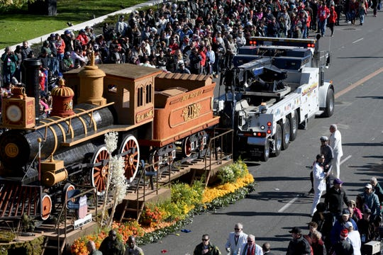 A tow truck had to move the Chinese American Heritage Foundation float after it broke down and erupted in smoke at the Rose Parade on Tuesday. The parade was briefly interrupted when the float celebrating U.S. railroad heritage blocked the way of other floats.