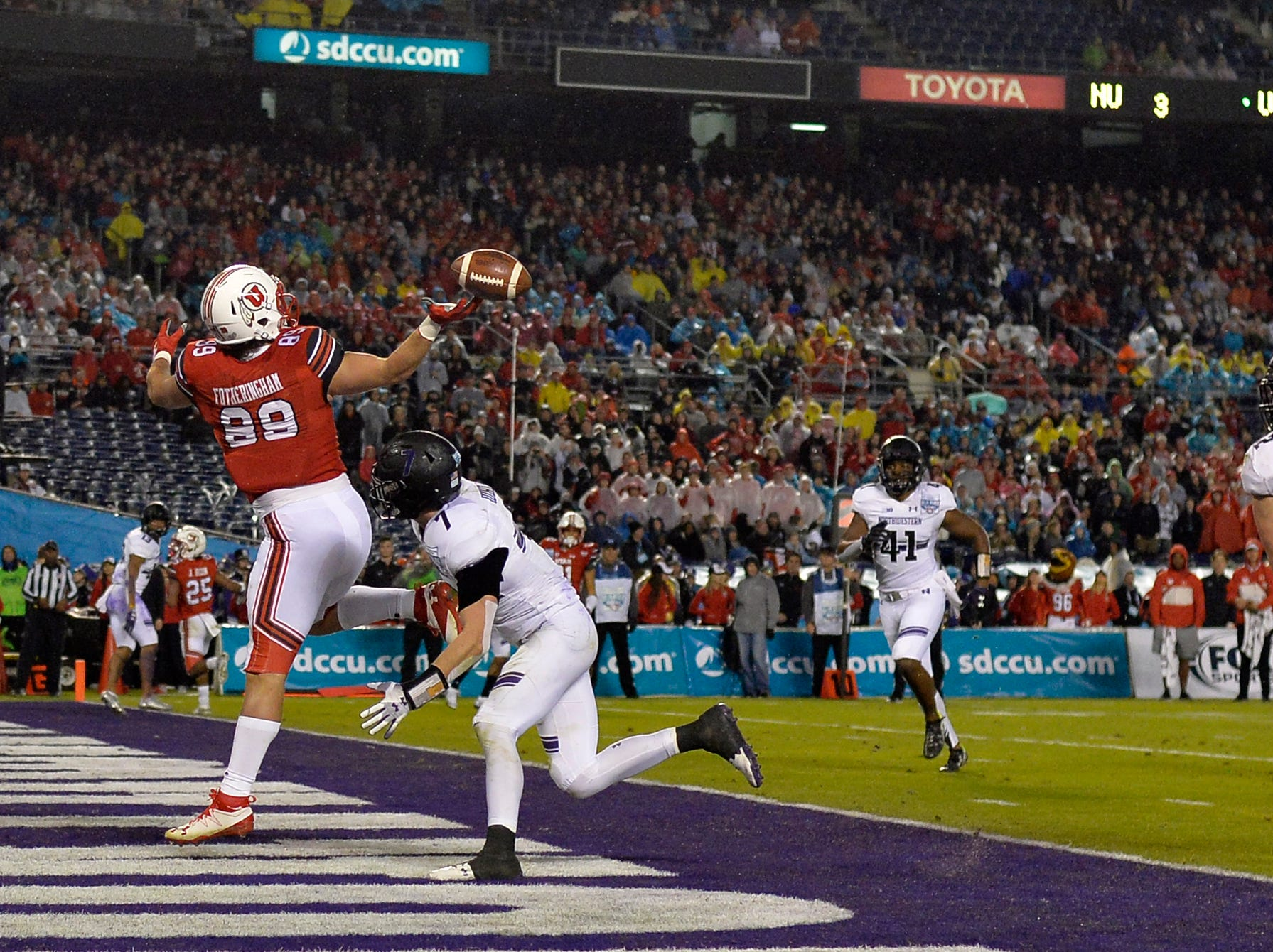 Utah Utes tight end Cole Fotheringham (89) cannot make a catch as Northwestern Wildcats defensive back Travis Jack Whillock (7) defends during the second quarter in the Holiday Bowl.