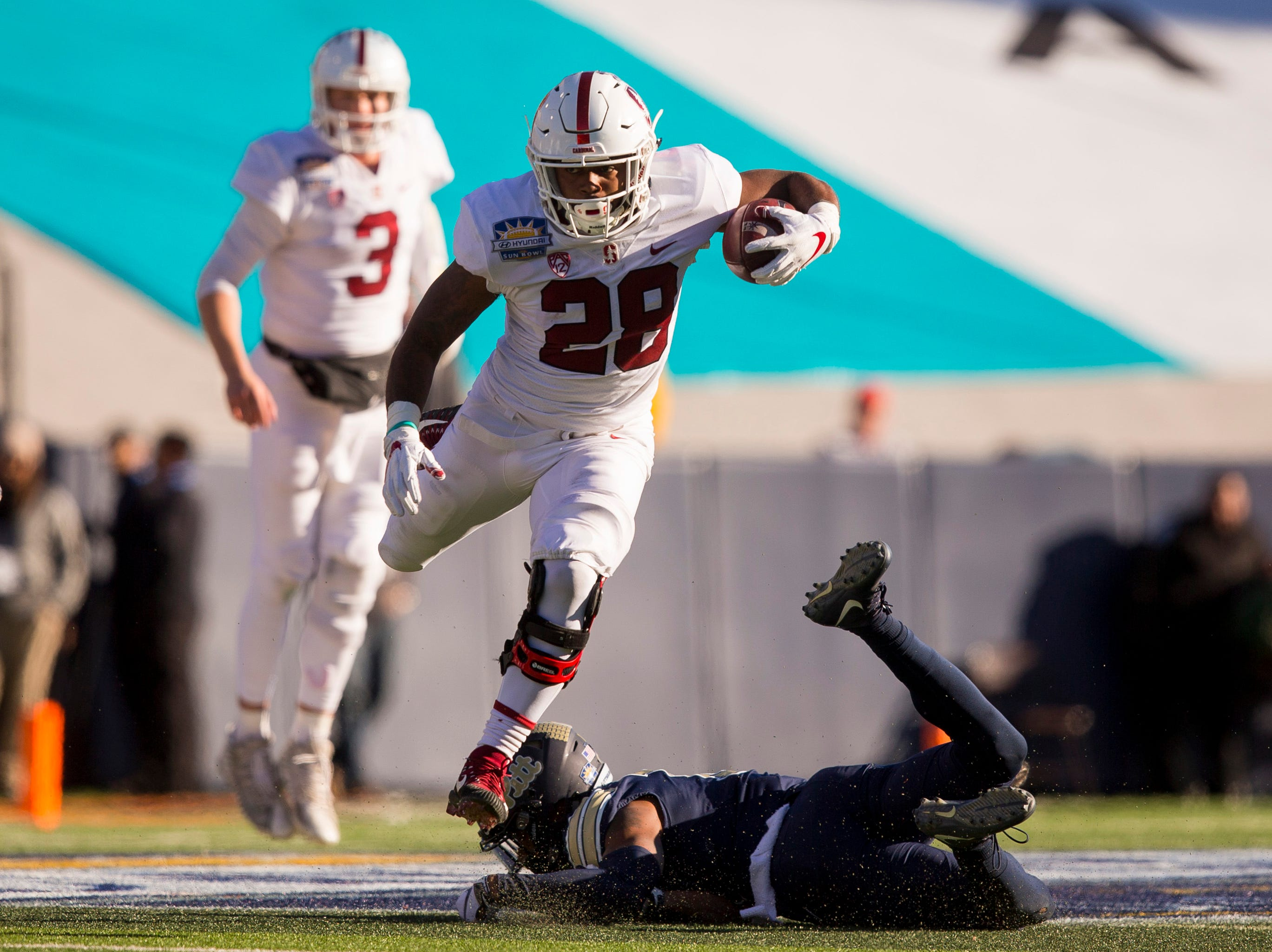 Stanford Cardinal running back Dorian Logan (28) runs the ball against the Pittsburgh Panthers in the Sun Bowl.