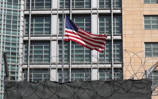 A U.S. flag waves in front of the Embassy of the United States in Moscow, Russia, on March 30, 2018.