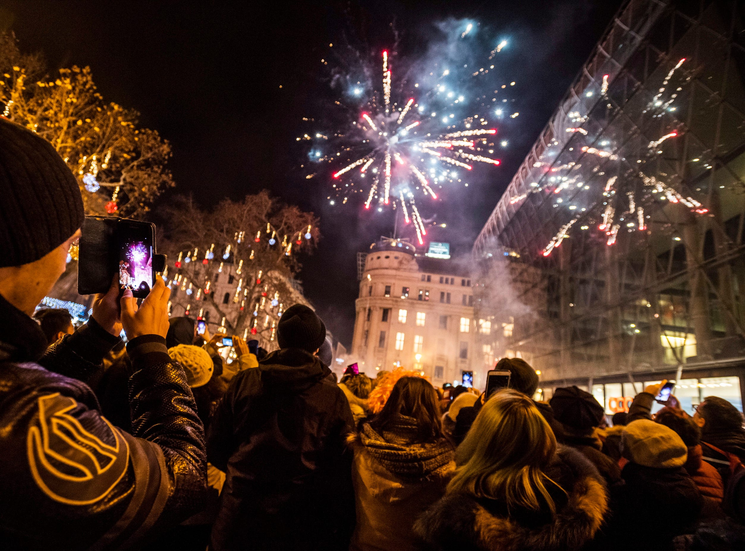 People welcome the arrival of 2019 on Vorosmarty square, Budapest, Hungary, Monday.