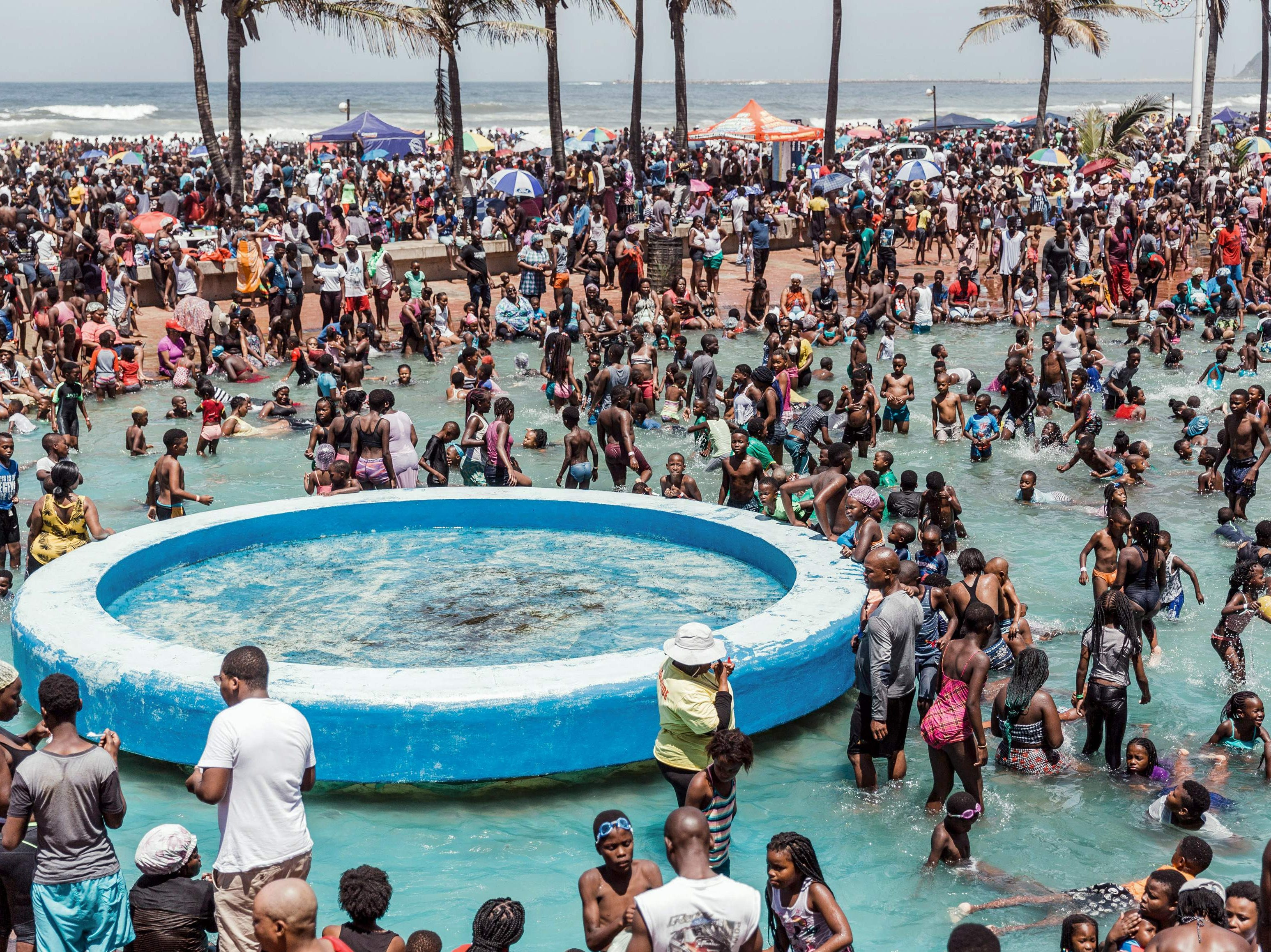 Thousands of revelers and holiday makers gather at the North Pier Beach during New Year Celebrations in Durban on Jan. 1, 2019. According to the police close to 100,000 people are expected to spend the day at the beach. The city situated on the east coast of the African Continent attracts thousands of local and international tourists boosting the local economy at this time of the year.