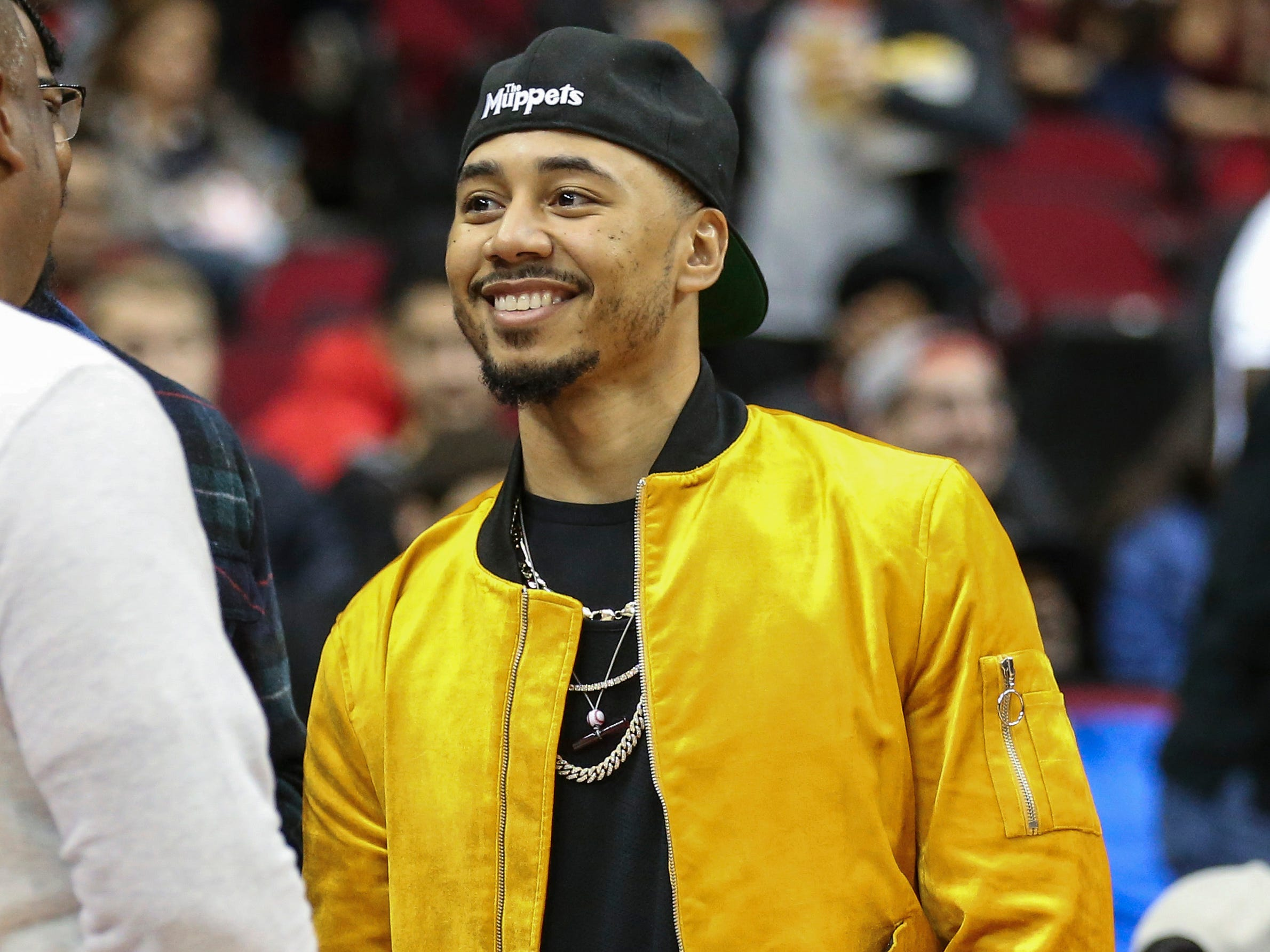 Dec. 31: Boston Red Sox right fielder Mookie Betts smiles while attending a game between the Houston Rockets and the Memphis Grizzlies at Toyota Center.