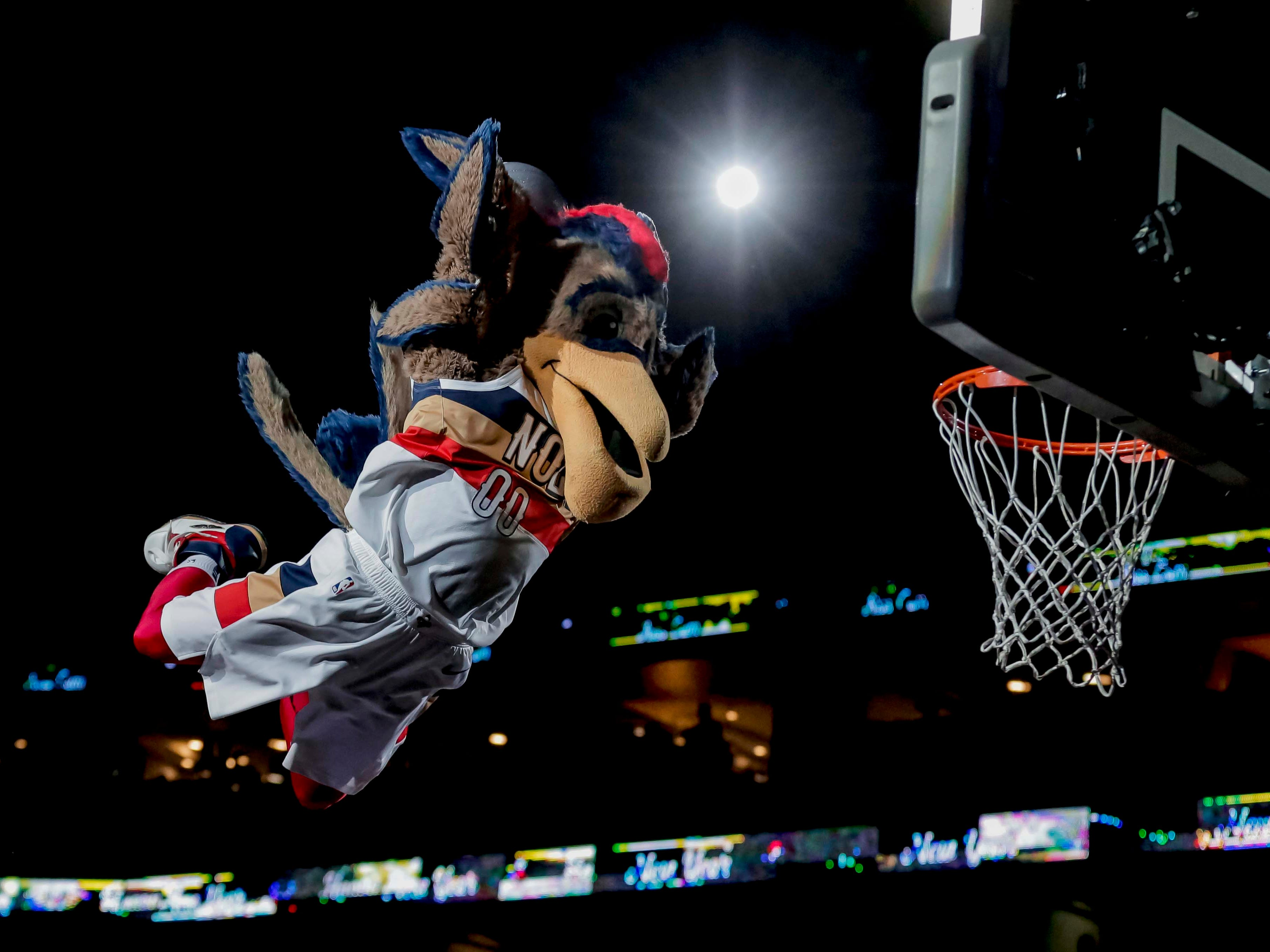 Dec. 31: New Orleans Pelicans mascot Pierre the Pelican performs a dunk in a timeout during the game against the Minnesota Timberwolves at the Smoothie King Center.