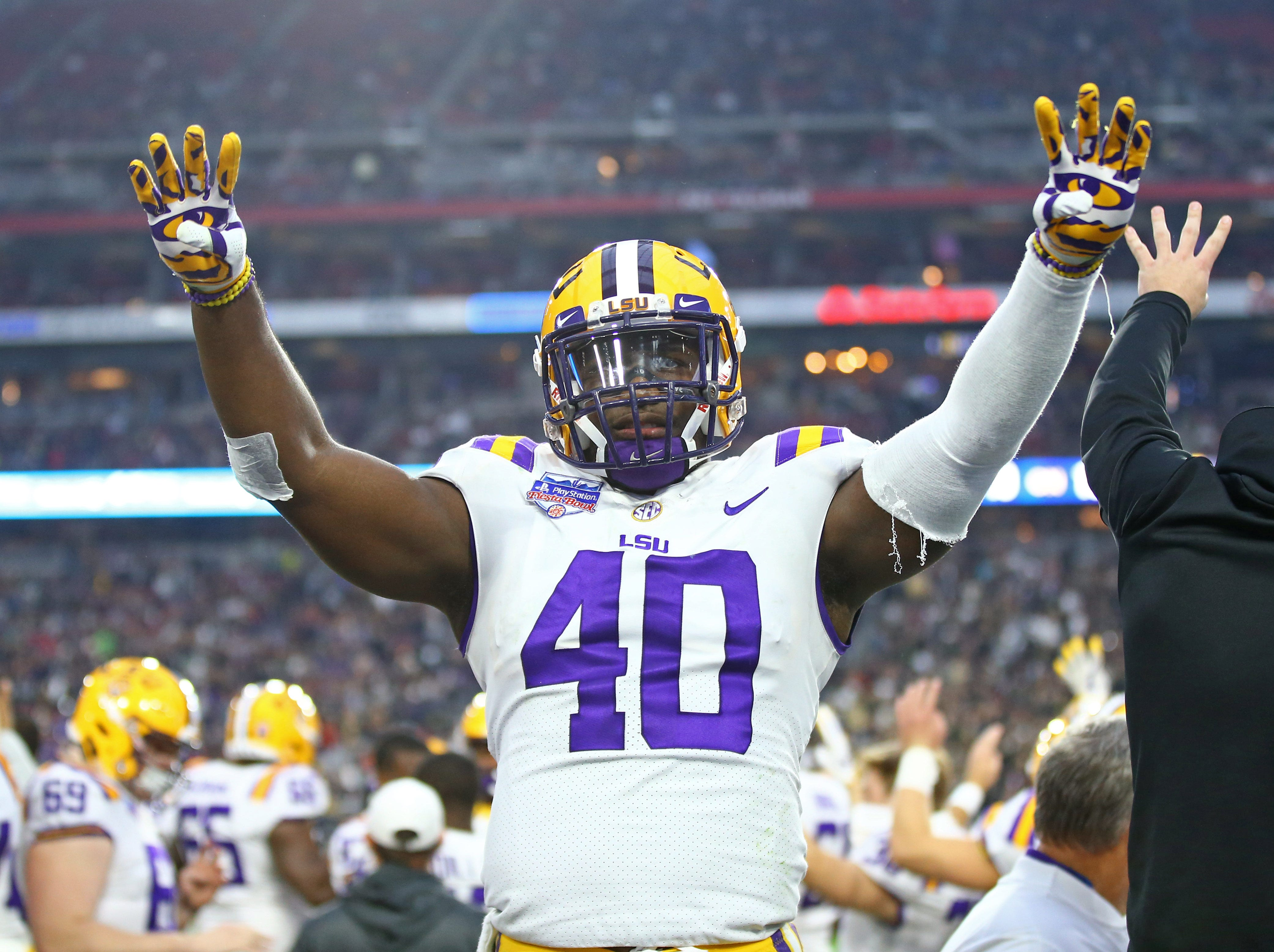 LSU Tigers linebacker Devin White (40) reacts in the fourth quarter against the UCF Knights in the Fiesta Bowl.